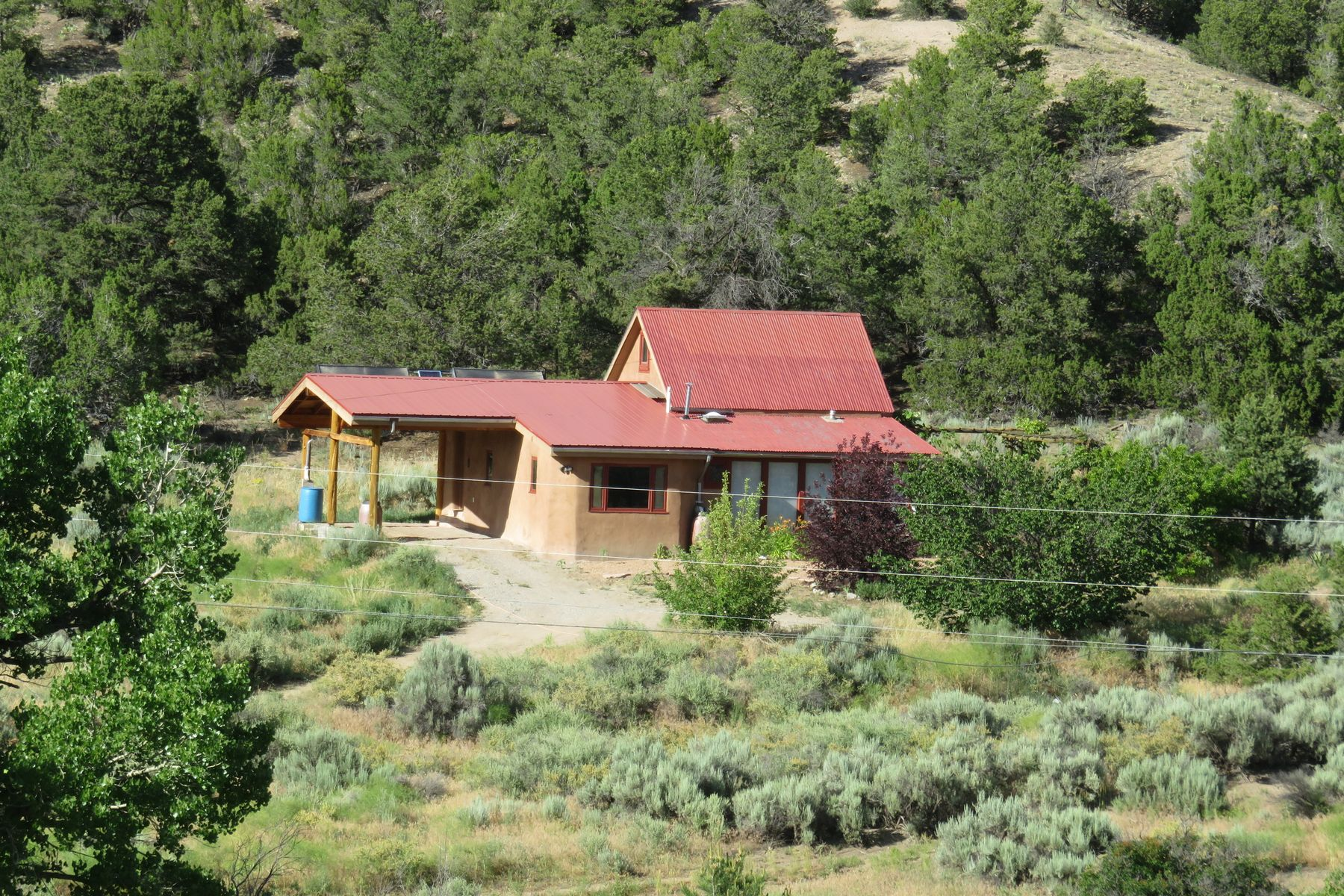 Single Family Homes للـ Sale في Ojo Sarco, New Mexico 87521 United States