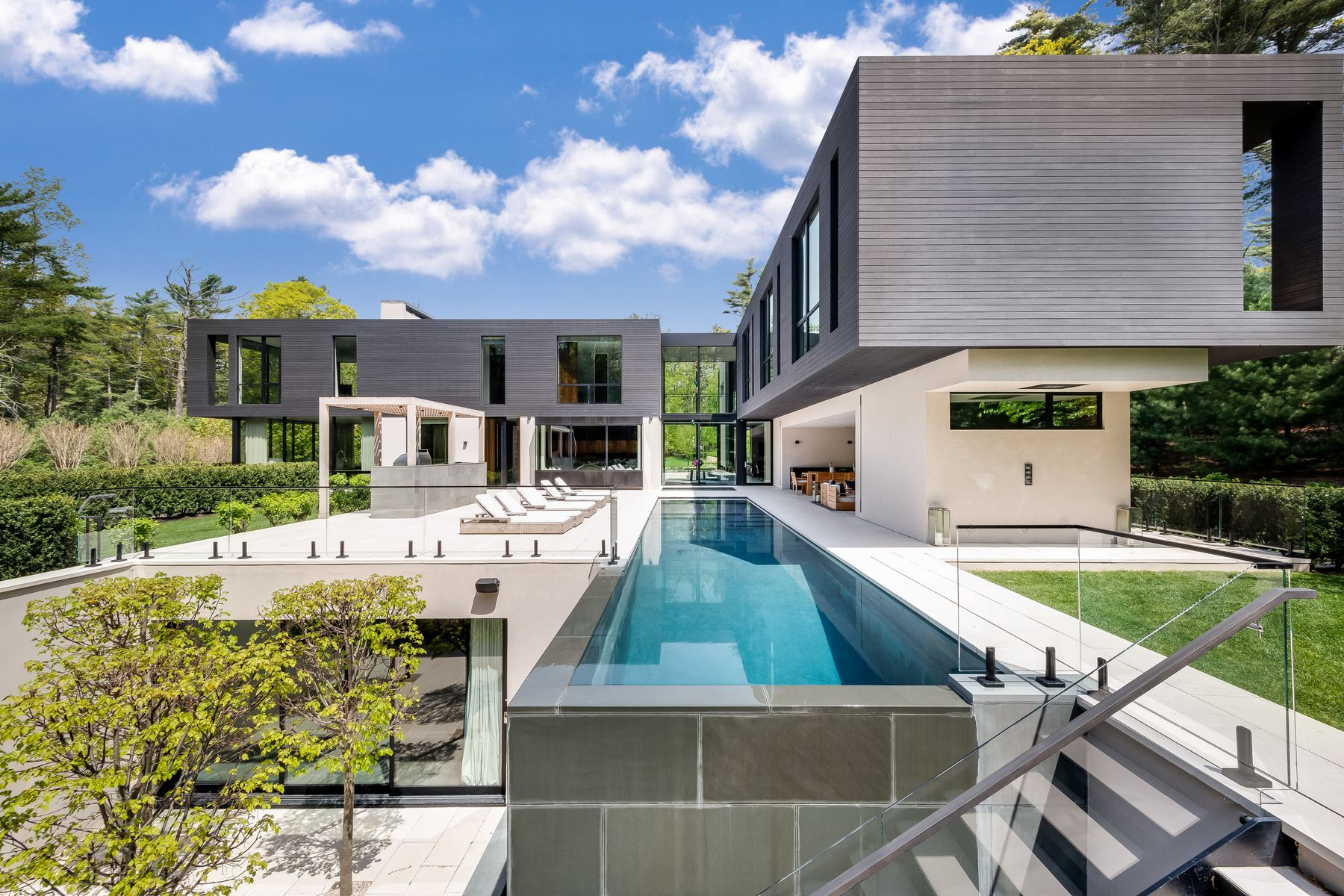 Single Family Homes for Active at Resolutely Private Modern Masterpiece 98 Bull Path East Hampton, New York 11937 United States
