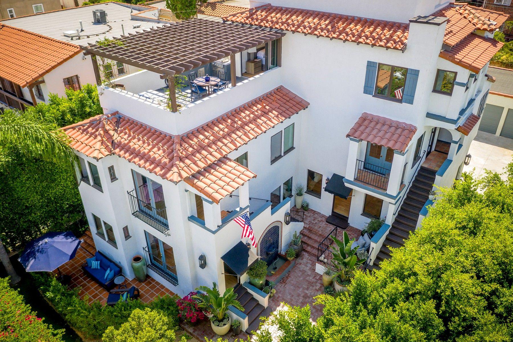 Multi-Family Homes por un Venta en 1055 South Sycamore Avenue Los Angeles, California 90019 Estados Unidos
