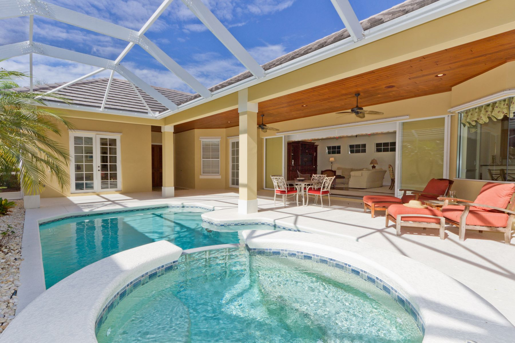 Single Family Homes for Sale at Tropical Courtyard Style Pool Home with Guest Casita 9240 Spring Time Drive Vero Beach, Florida 32963 United States