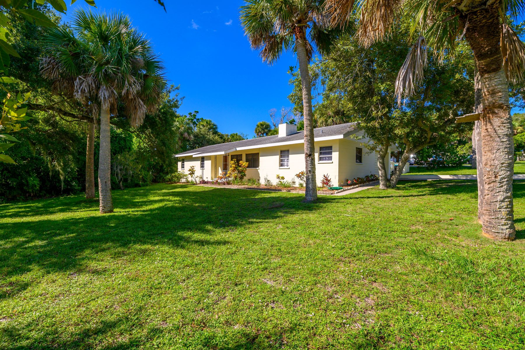Single Family Homes for Sale at Charming Home Nestled in Unique Riverfront Community 1419 Anglers Ne Drive Palm Bay, Florida 32905 United States