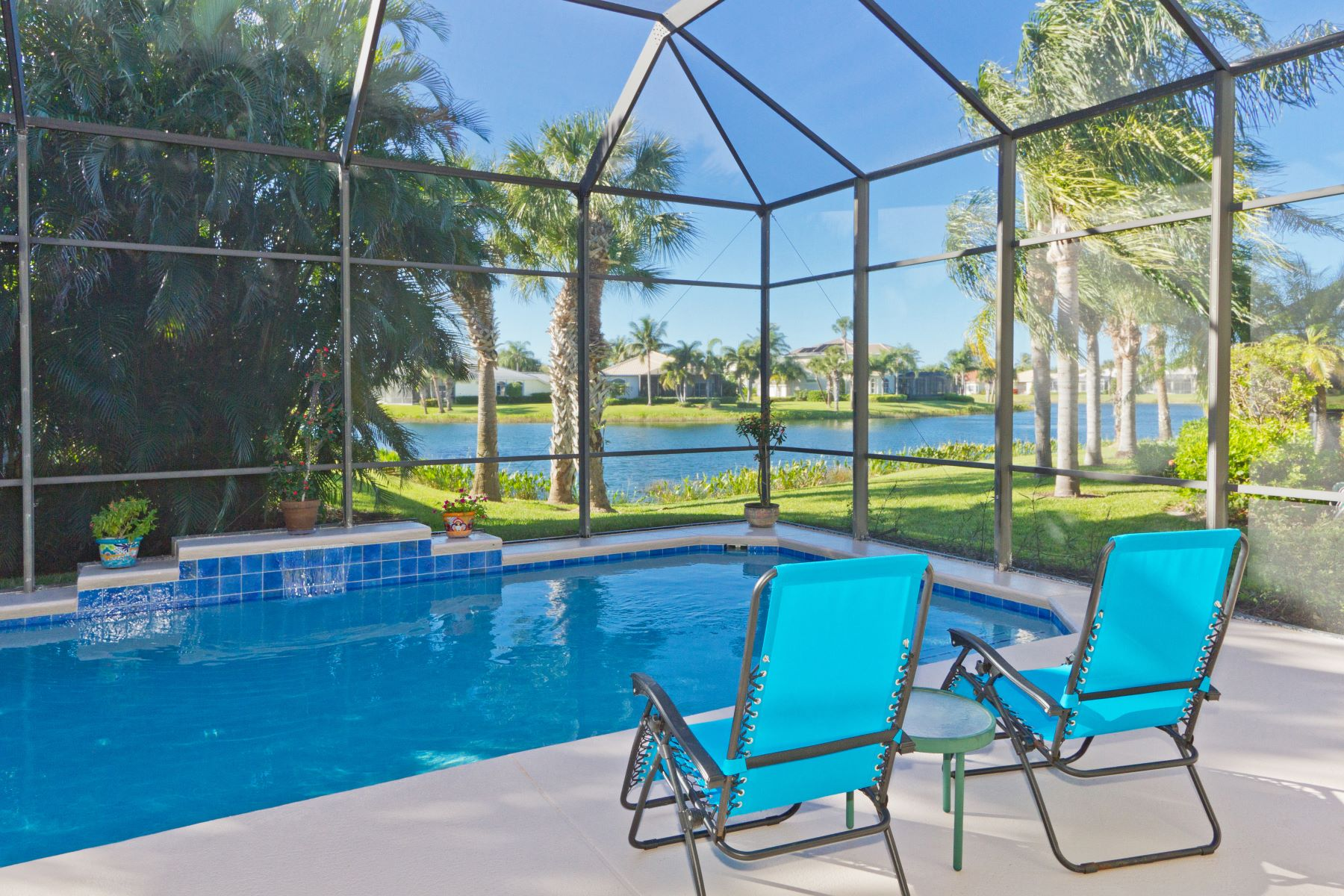 Single Family Homes for Sale at Enjoy Poolside Living with Lake Views! 1338 Riverside Lane Vero Beach, Florida 32963 United States