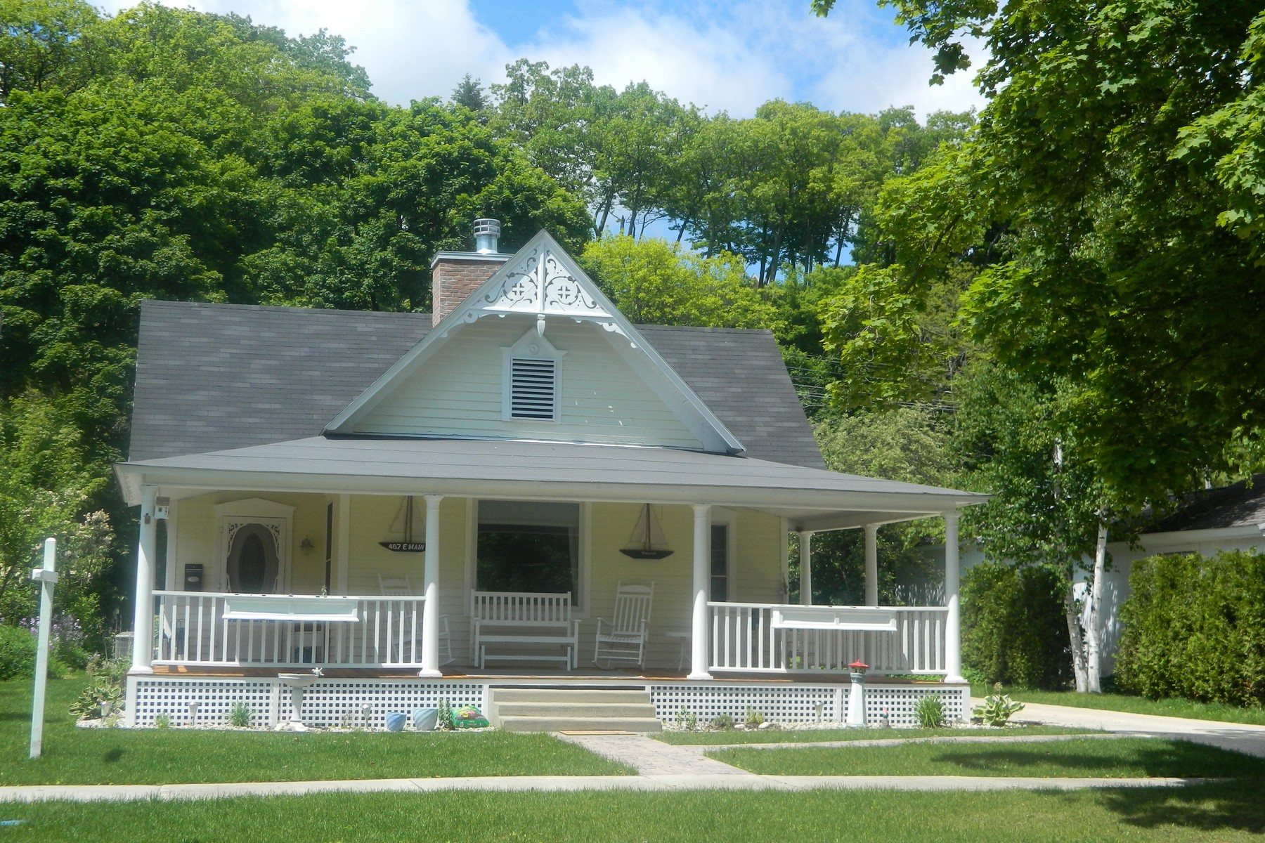 Property For Sale at Timeless Harbor Springs Cottage Style Home with Guest House