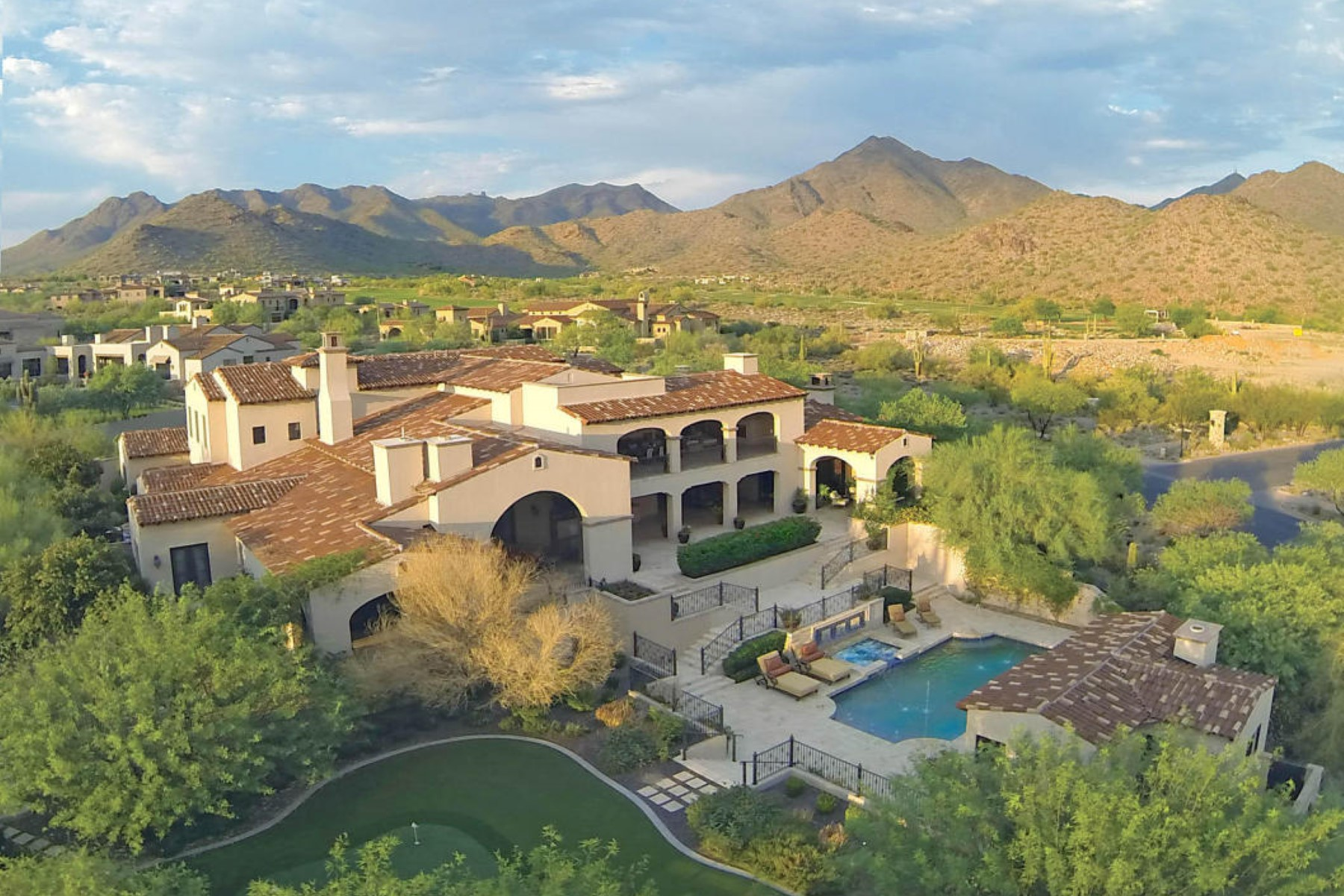 Single Family Home for Sale at Stunning Bing Hu estate offers sweeping mountain and city views 19042 N 102nd St Scottsdale, Arizona 85255 United States