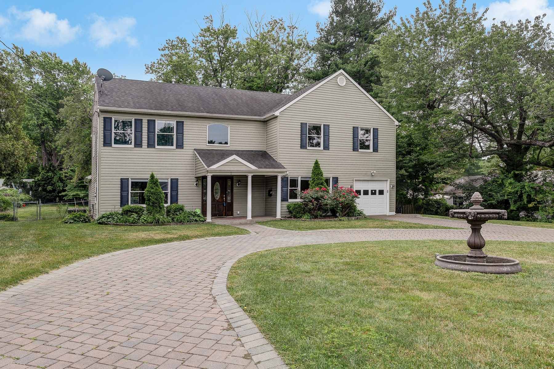 sales property at Center Hall Colonial with Open Floor Plan