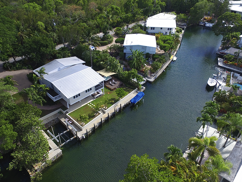 Single Family Home for Sale at Serene Canalfront Home 150 Rushton Lane Key Largo, Florida, 33037 United States