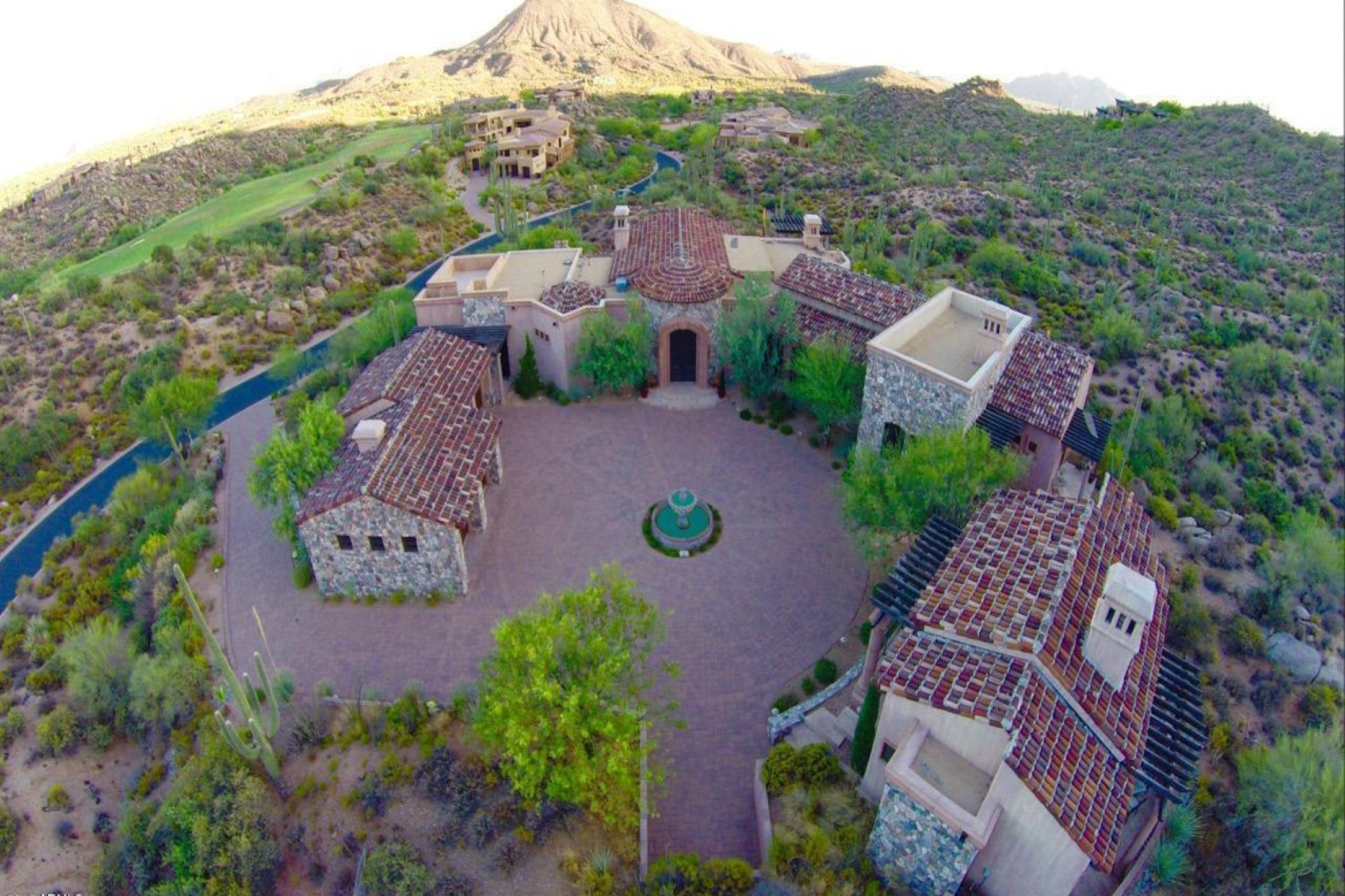 sales property at Beautiful private Tuscan home is situated on 2.2 acres in Saguaro Forest