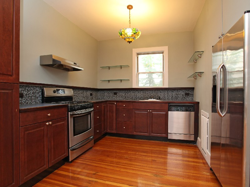 Property Of Renovated 4 BR + Rear Yard