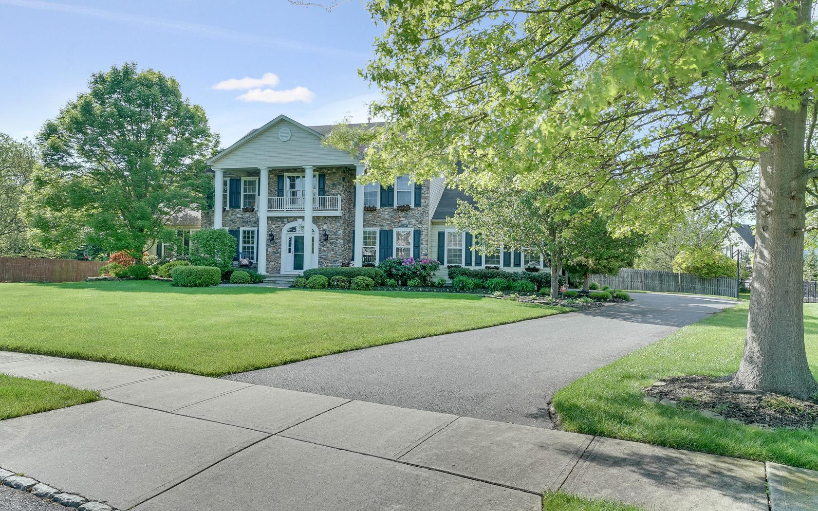 sales property at Stately Colonial in Orchard Ridge!