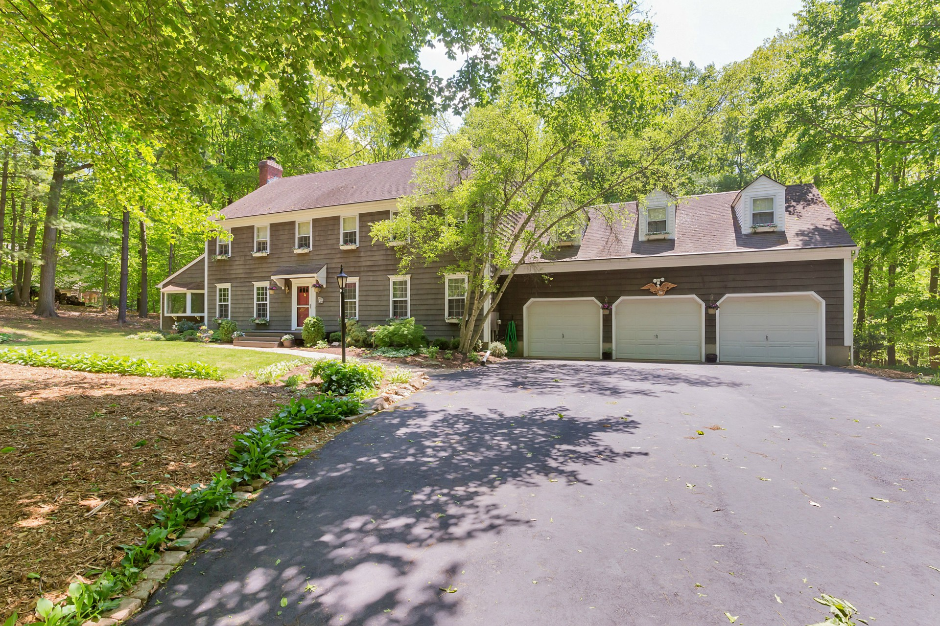 sales property at Lovely Colonial on Wooded Property