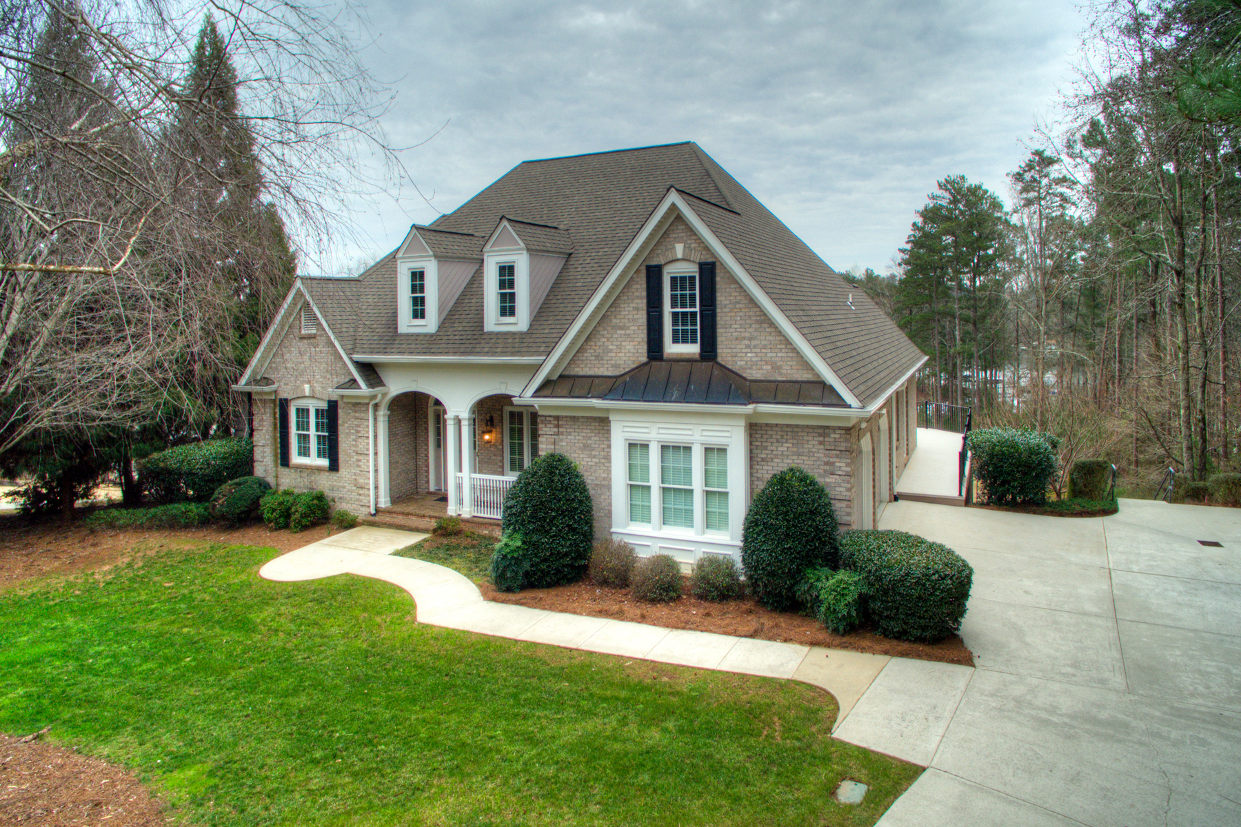 Property For Sale at Beautiful Four Sided Brick Lake Front Home