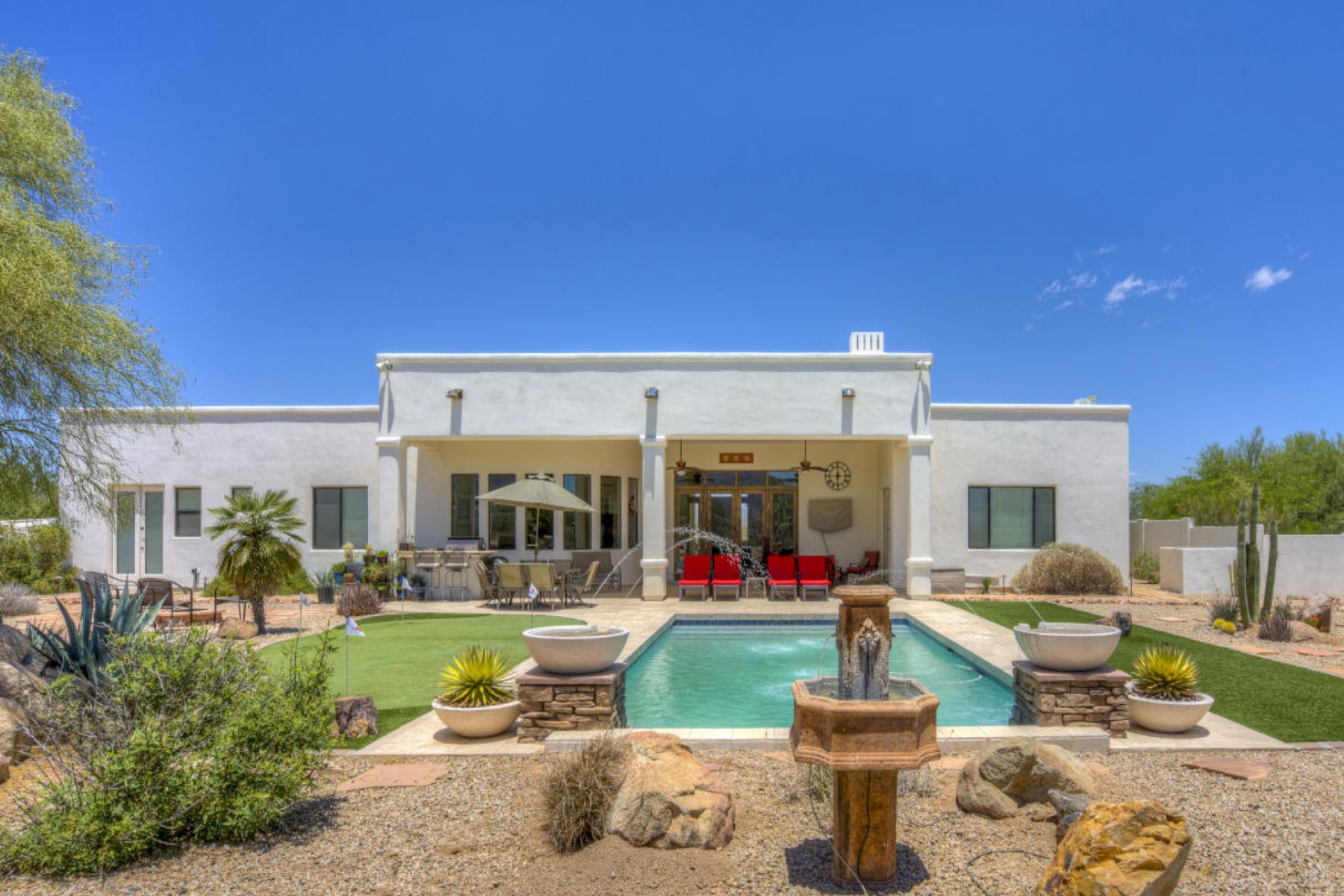 Single Family Home for Sale at Ultimate desert living in this stunning home on 1.25 acres 13813 E Quail Track Rd Scottsdale, Arizona, 85262 United States