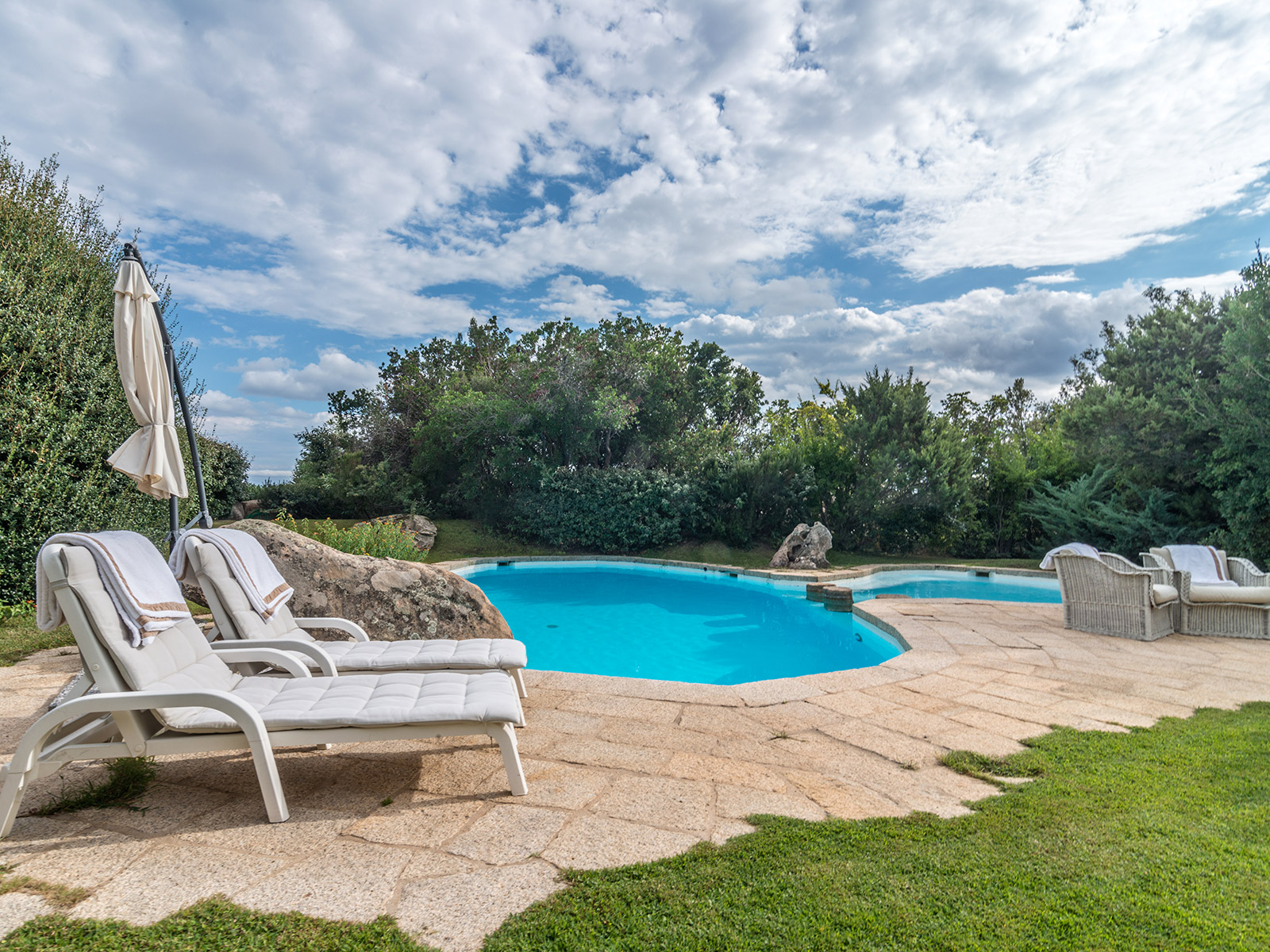 Additional photo for property listing at Magnificent sardinian style villa with private garden Via degli Stazzi Arzachena, Olbia Tempio 07021 Italia
