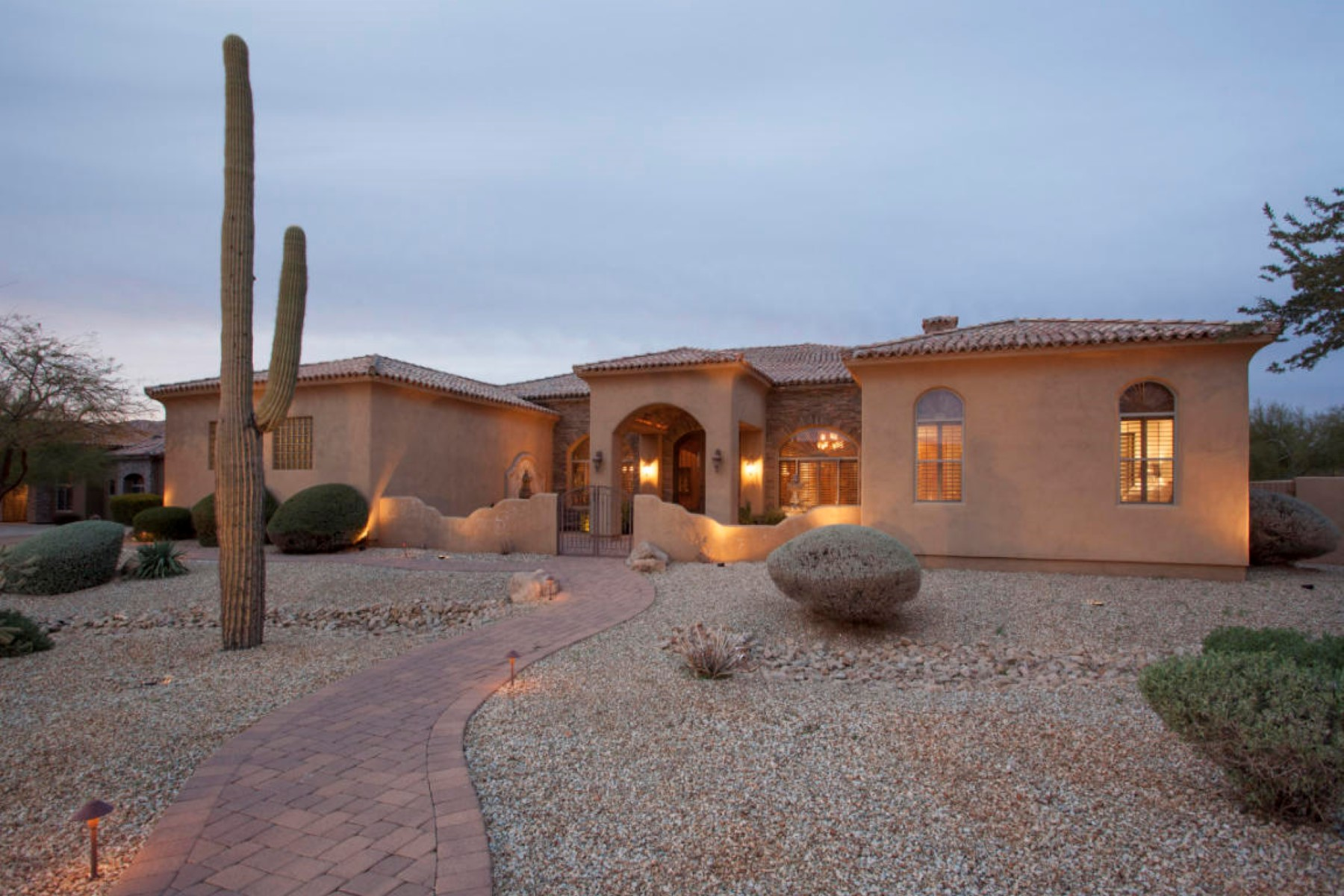 Property For Sale at Tuscan inspired custom home on almost an acre