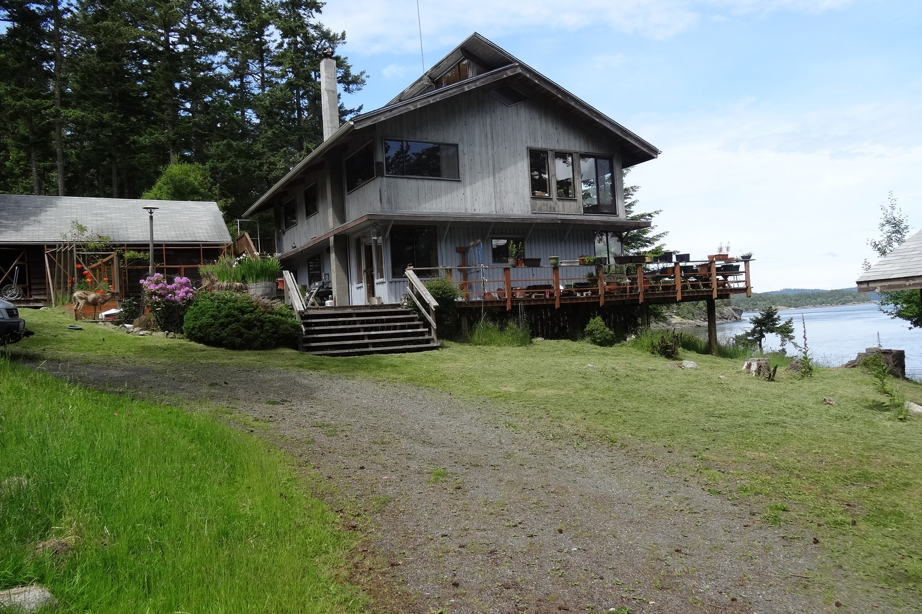 sales property at Rustic Waterfront Home Sits on 17.7 Acres