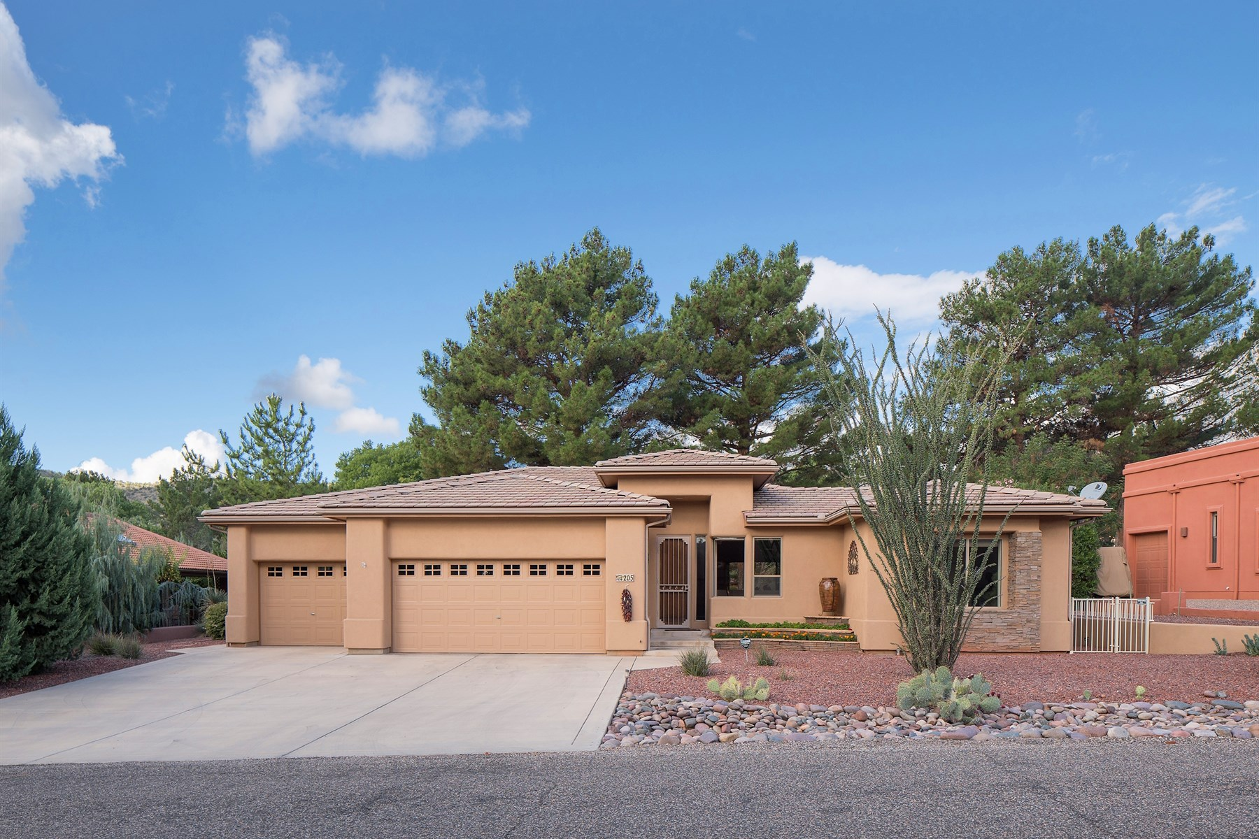 Single Family Home for Sale at Situated at the 17th green of the Oak Creek Country Club 205 Oakcreek Drive Sedona, Arizona 86351 United States