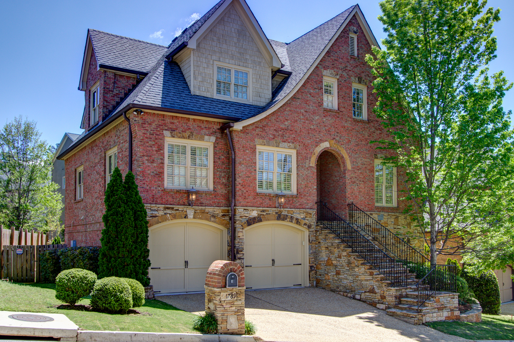 sales property at Refined Brick and Stone Executive Home in Charming Brookhaven Setting