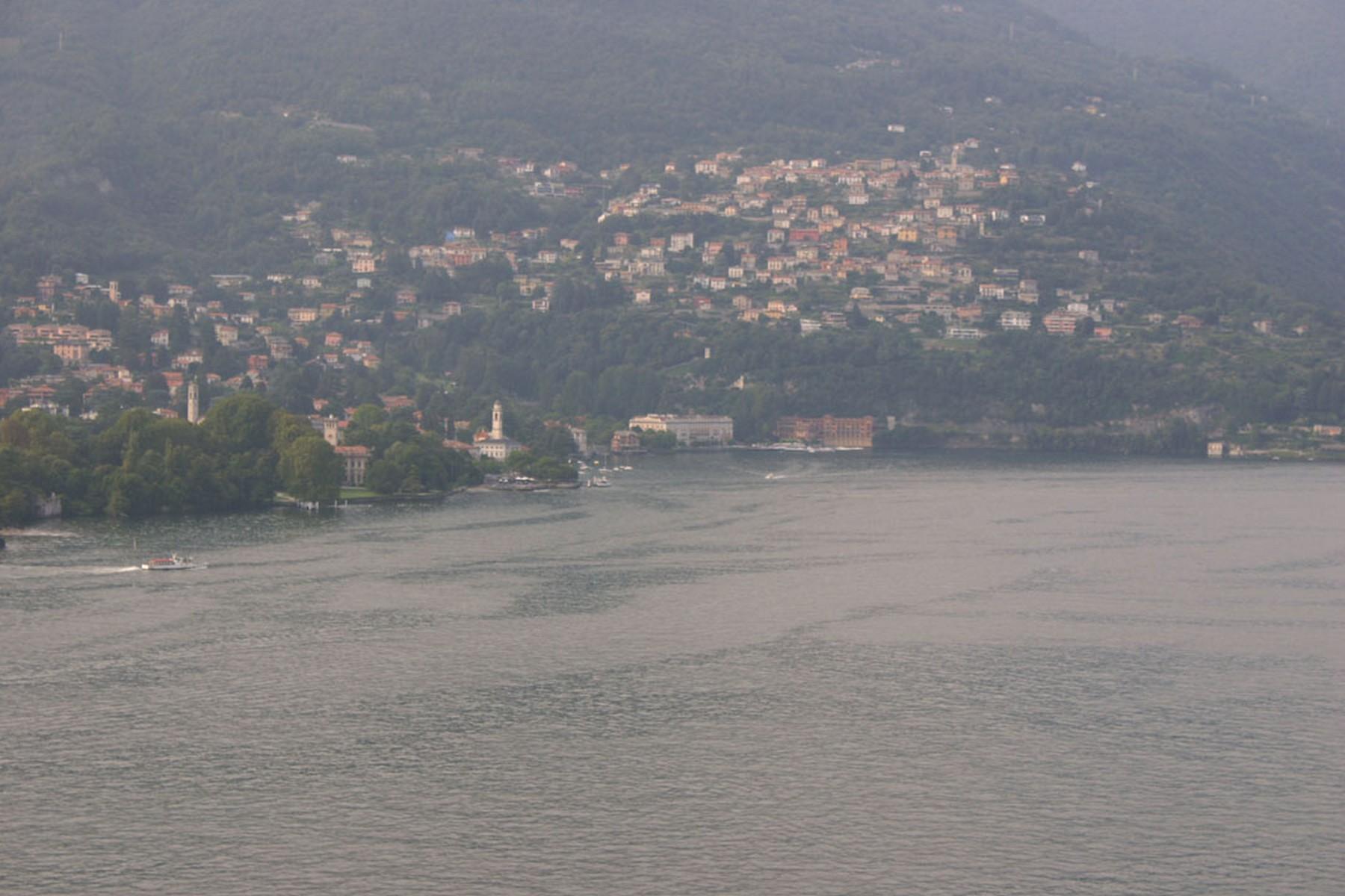 Additional photo for property listing at Prestigious newly built apartment with panoramic terrace Via Torno Como, Como 22100 Italie