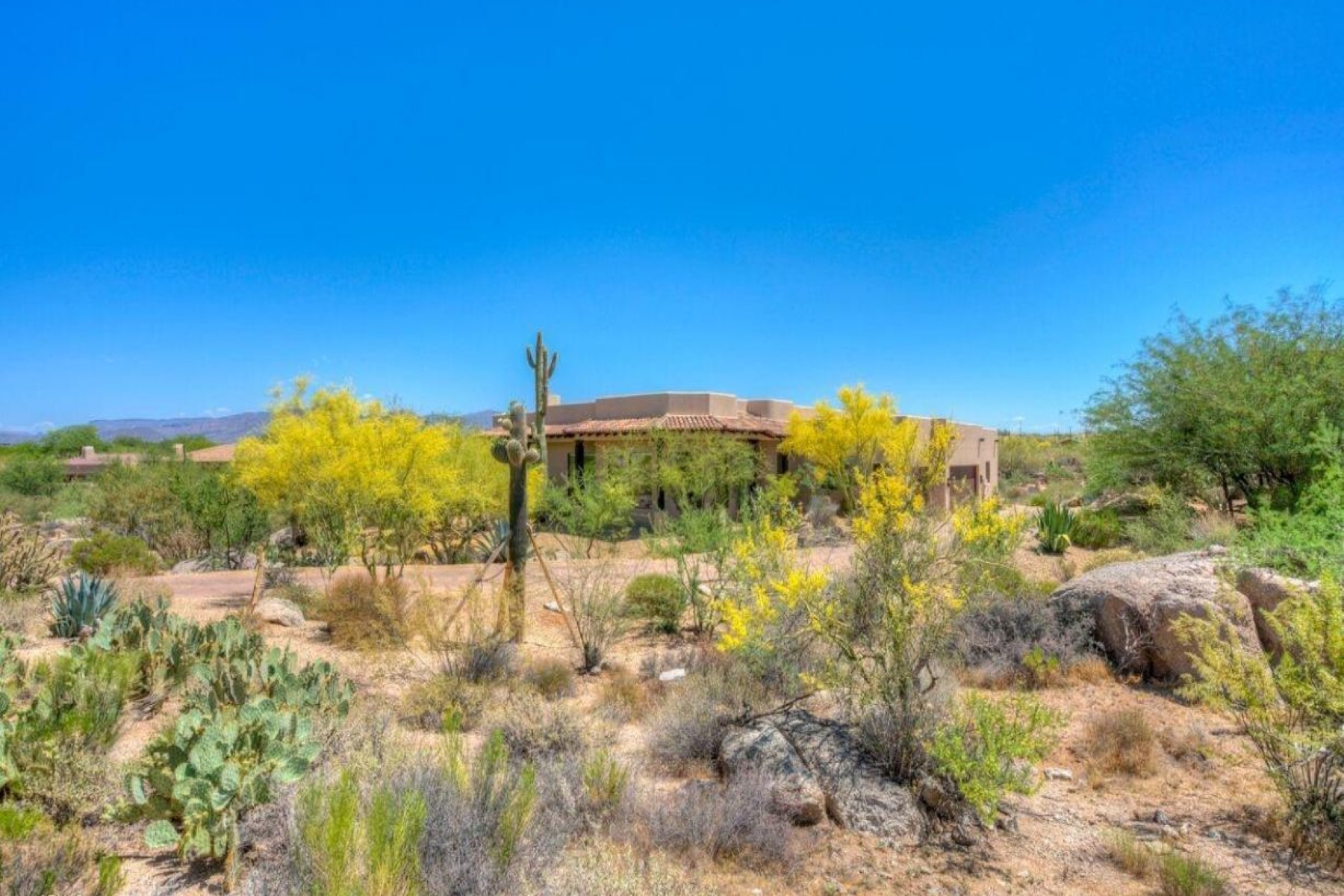 sales property at Custom Winfield home surrounded by mountain view