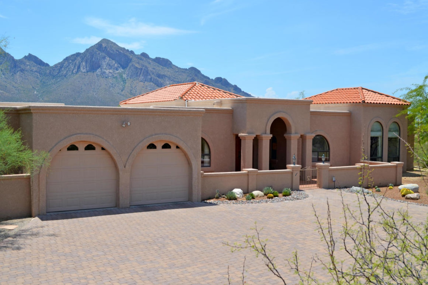 Property For Sale at Southwestern style retreat is nestled atop a ridge with spectacular views.