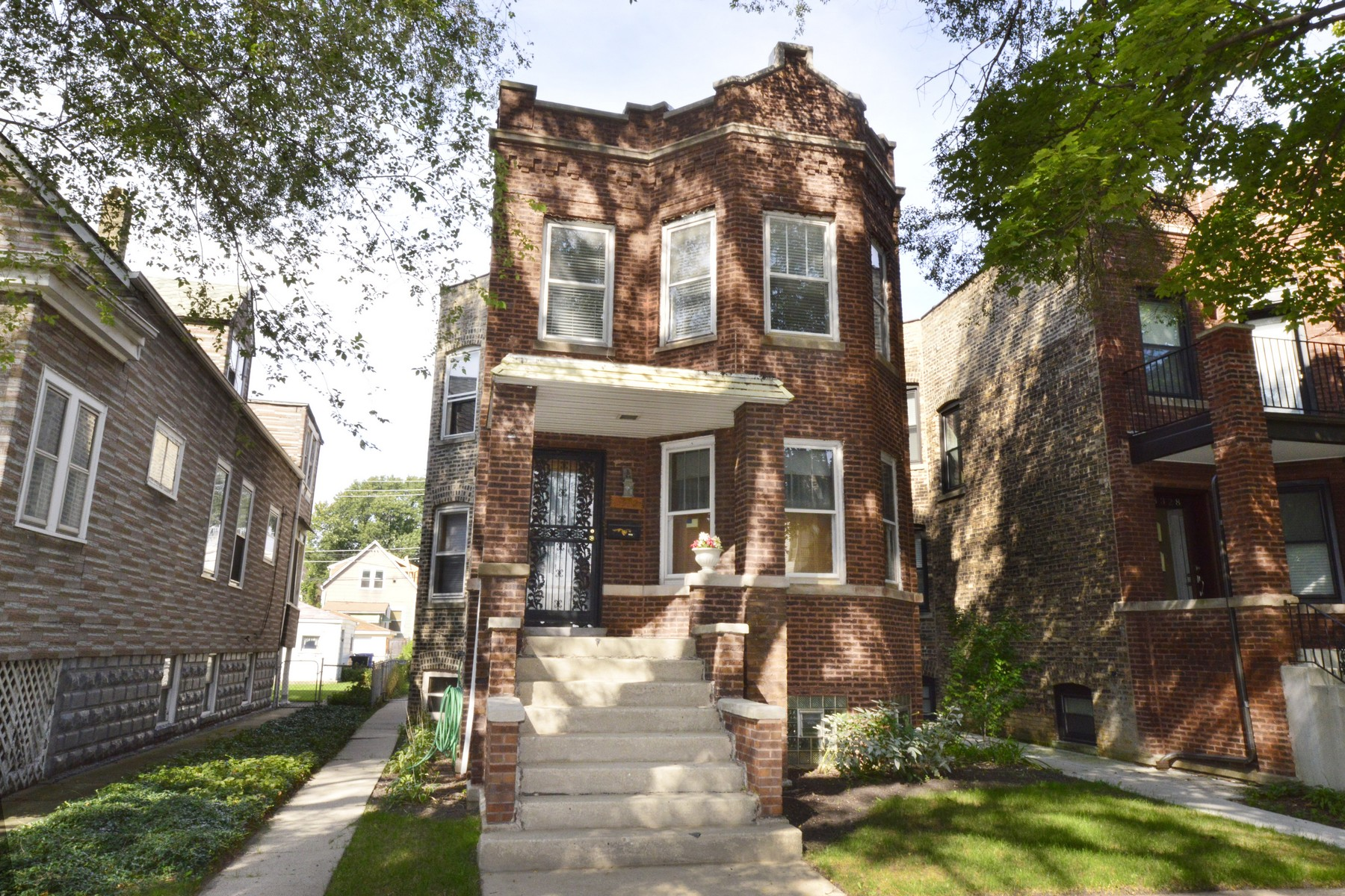 Multi-Family Home for Sale at Brick Irving Park Two Flat 3332 W Belle Plaine Avenue Irving Park, Chicago, Illinois 60618 United States