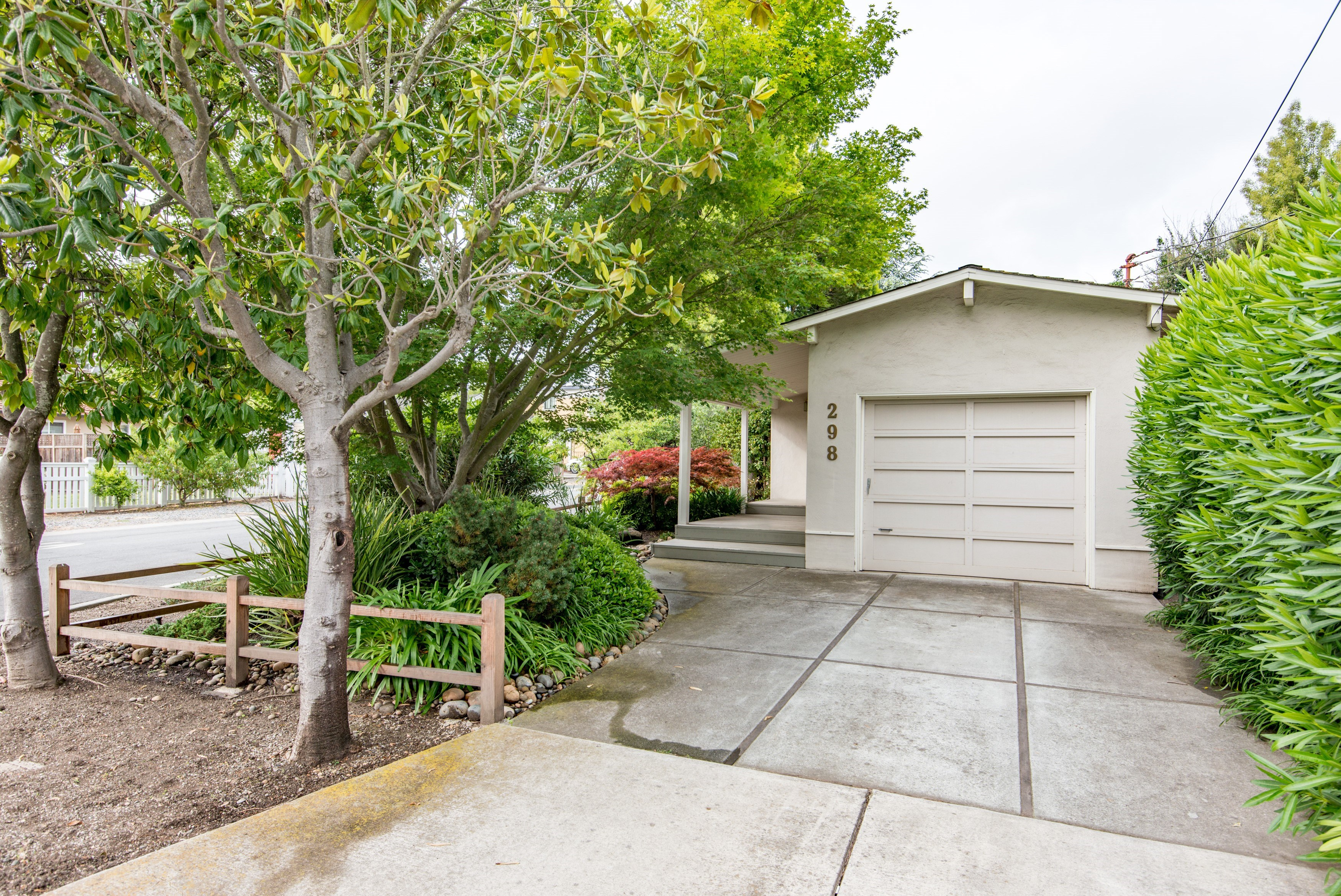 sales property at Prime Location – Quaint Cottage with beautiful low maintenance landscaping