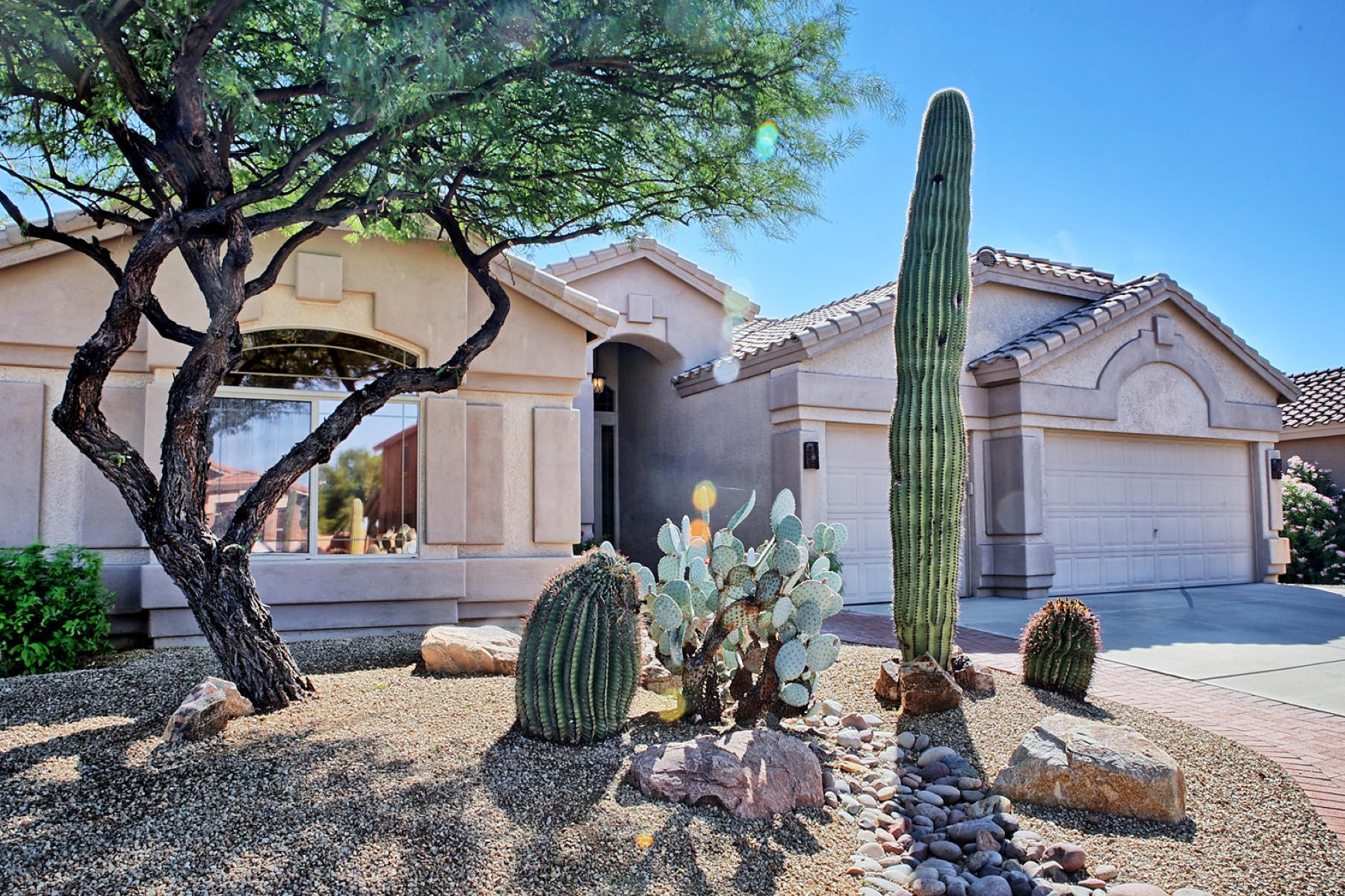 Property For Sale at Beautiful mountain views greet you as you enter this lovely Oro Valley home
