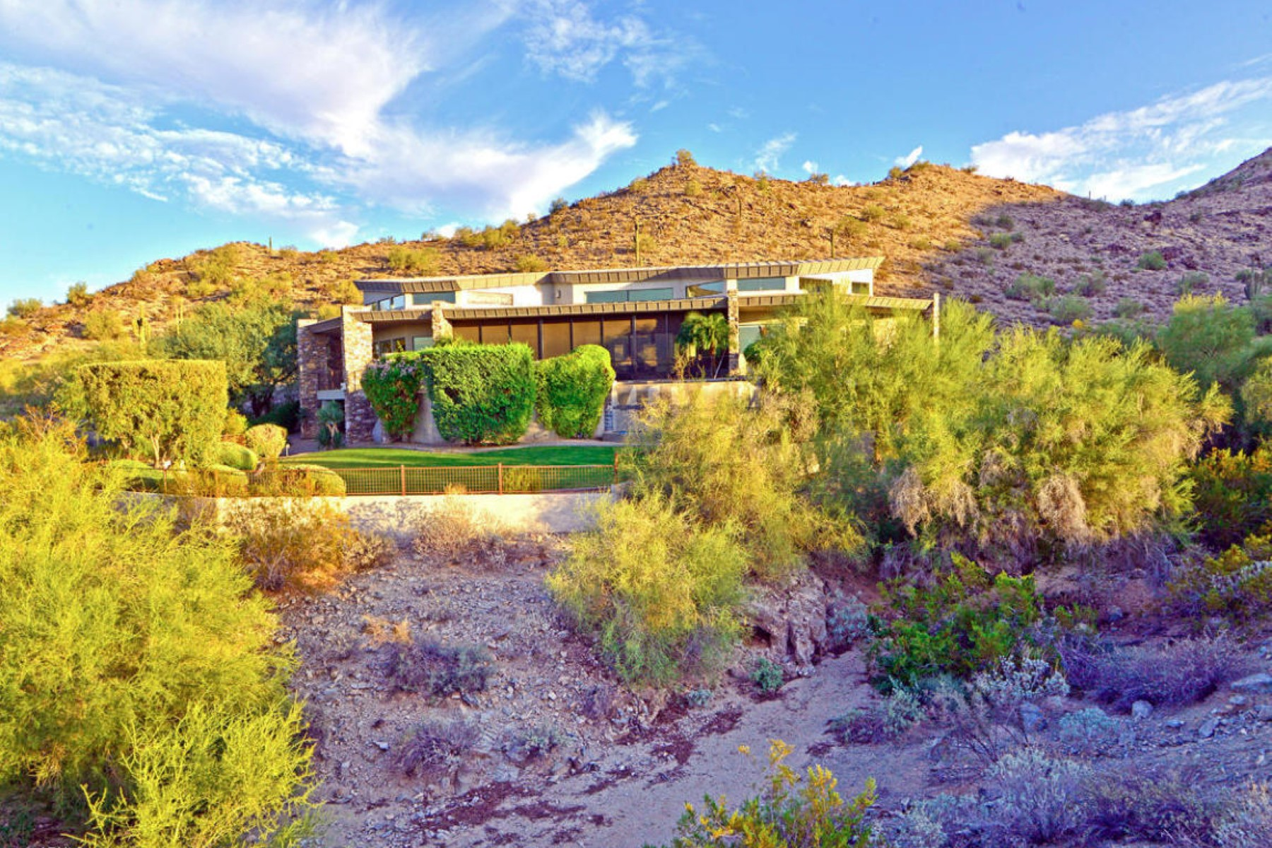 Property For Sale at Unique and dramatic contemporary in the quiet gated community of Highline Canyon