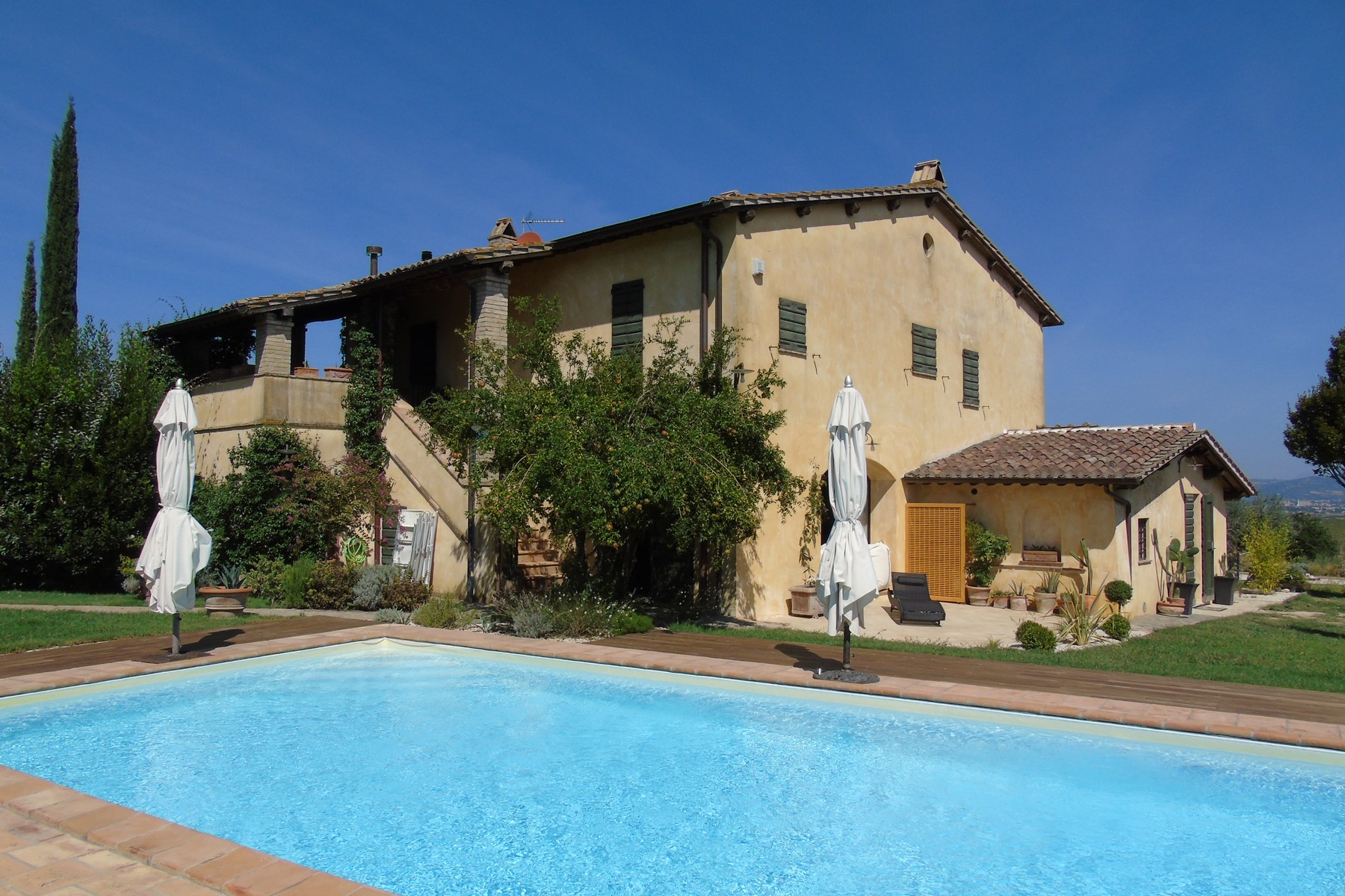 Townhouse for Sale at Lovely farmhouse with panaromic views of Assisi Via dei Colli Bettona Perugia, 06084 Italy