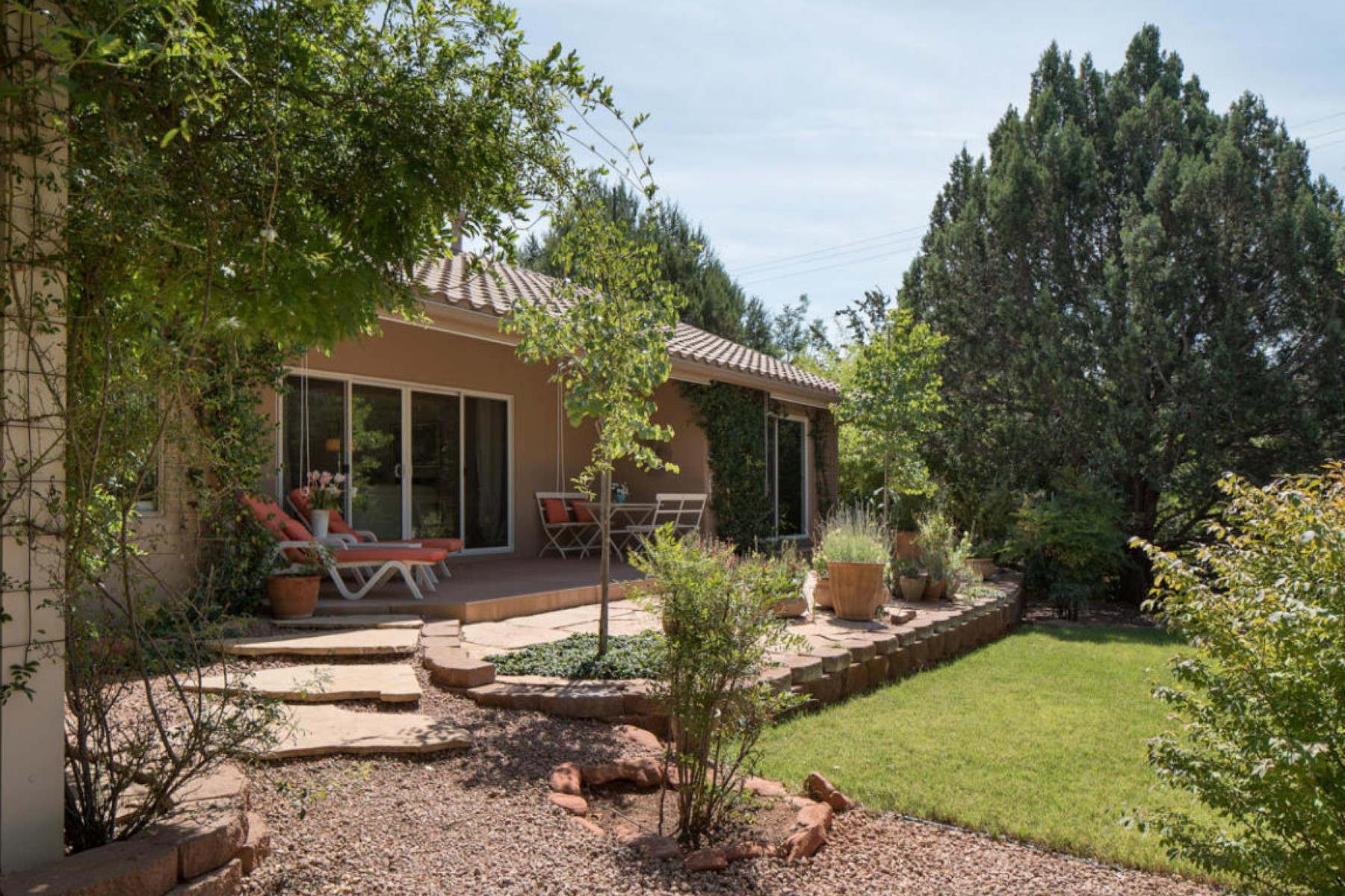 Single Family Home for Sale at .57 acre lot and surrounded by lush green enchanted gardens 35 Hohokam Drive Sedona, Arizona 86336 United States