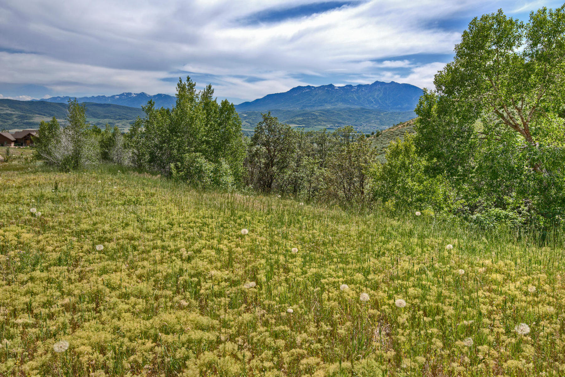 sales property at Home site boasts incredible views of Snowbasin Ski Resort & Pineview Reservoir