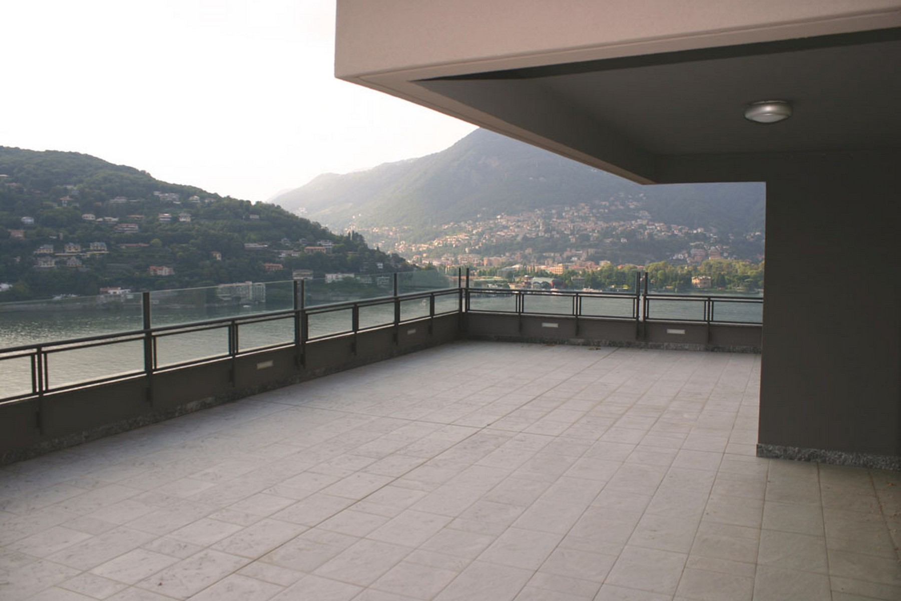 Additional photo for property listing at Prestigious newly built apartment with panoramic terrace Via Torno Como, Como 22100 Italy