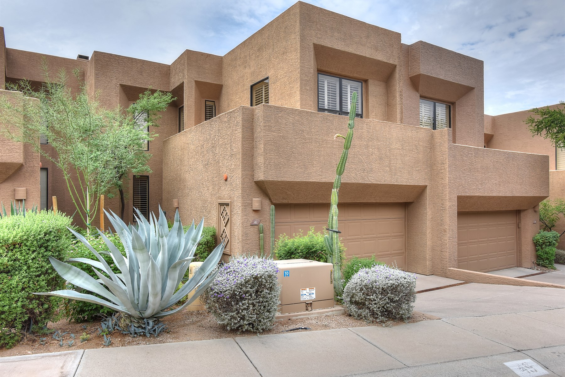 Townhouse for Sale at Private townhome is located in the Troon Village Community of Skye Top 25555 N Windy Walk Dr 49 Scottsdale, Arizona 85255 United States
