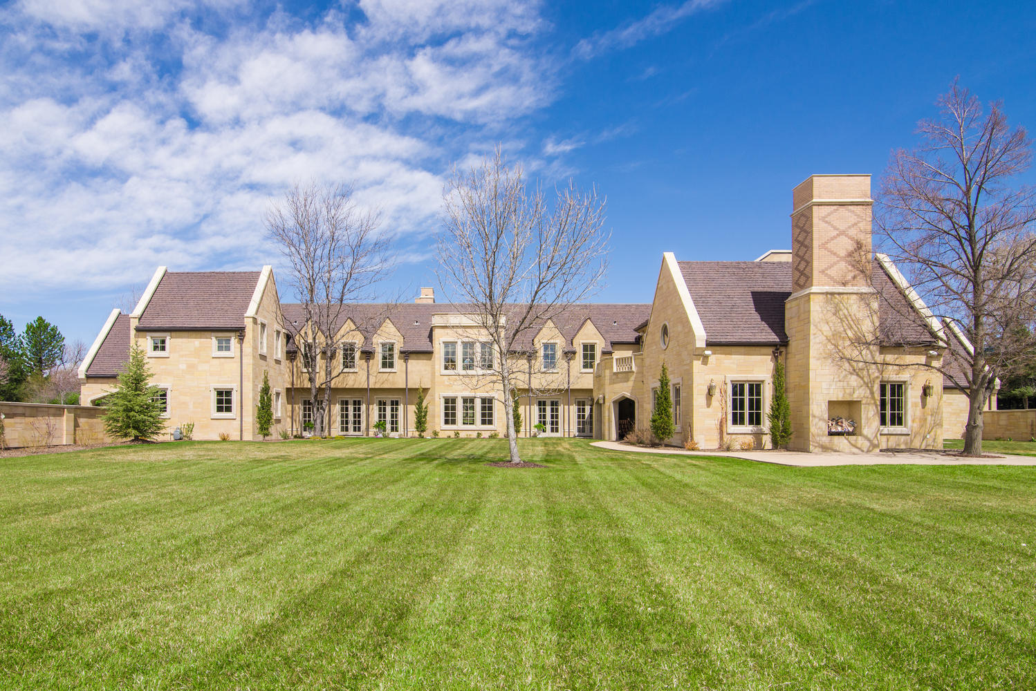 sales property at English manor style home nestled on 2.5 serene acres