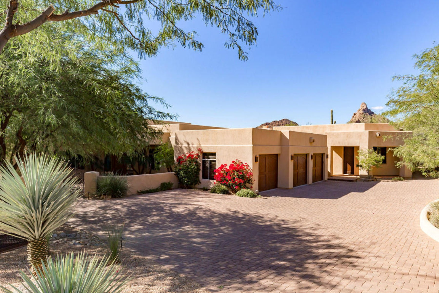 Single Family Home for Sale at Desert inspired residence in the guard gated community of Troon Mountain 25770 N 106th Way Scottsdale, Arizona, 85255 United States