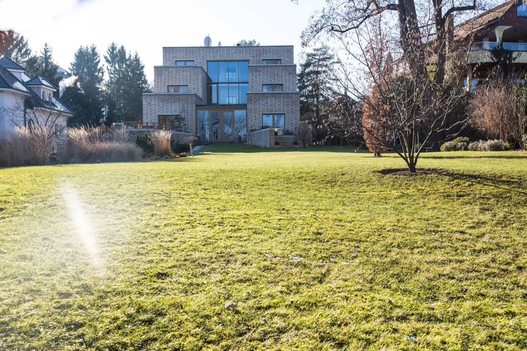 단독 가정 주택 용 매매 에 Luxurious architect´s villa directly by the Krampnitzsee Potsdam, Brandenburg, 14476 독일