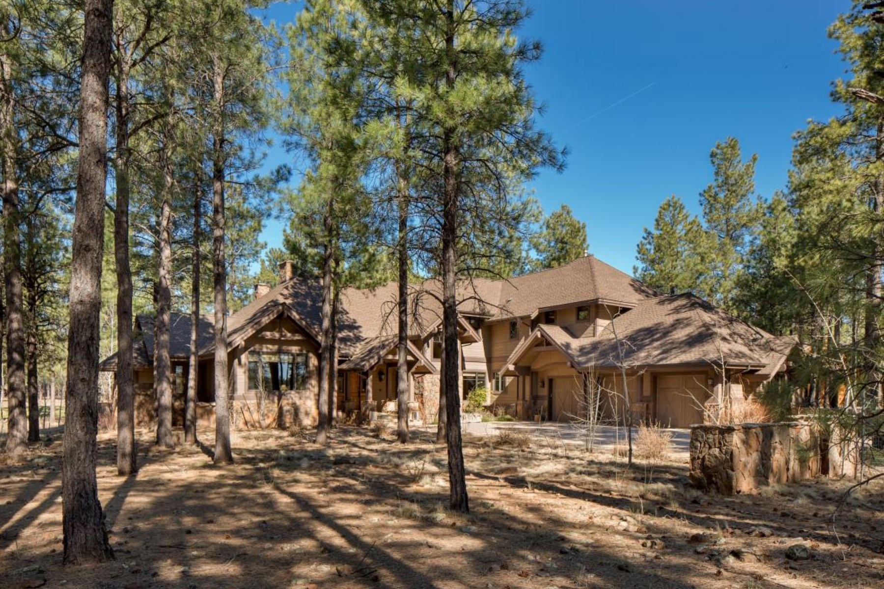 sales property at Custom Craftsman Estate nestled into the Meadows at Forest Highlands Golf Club
