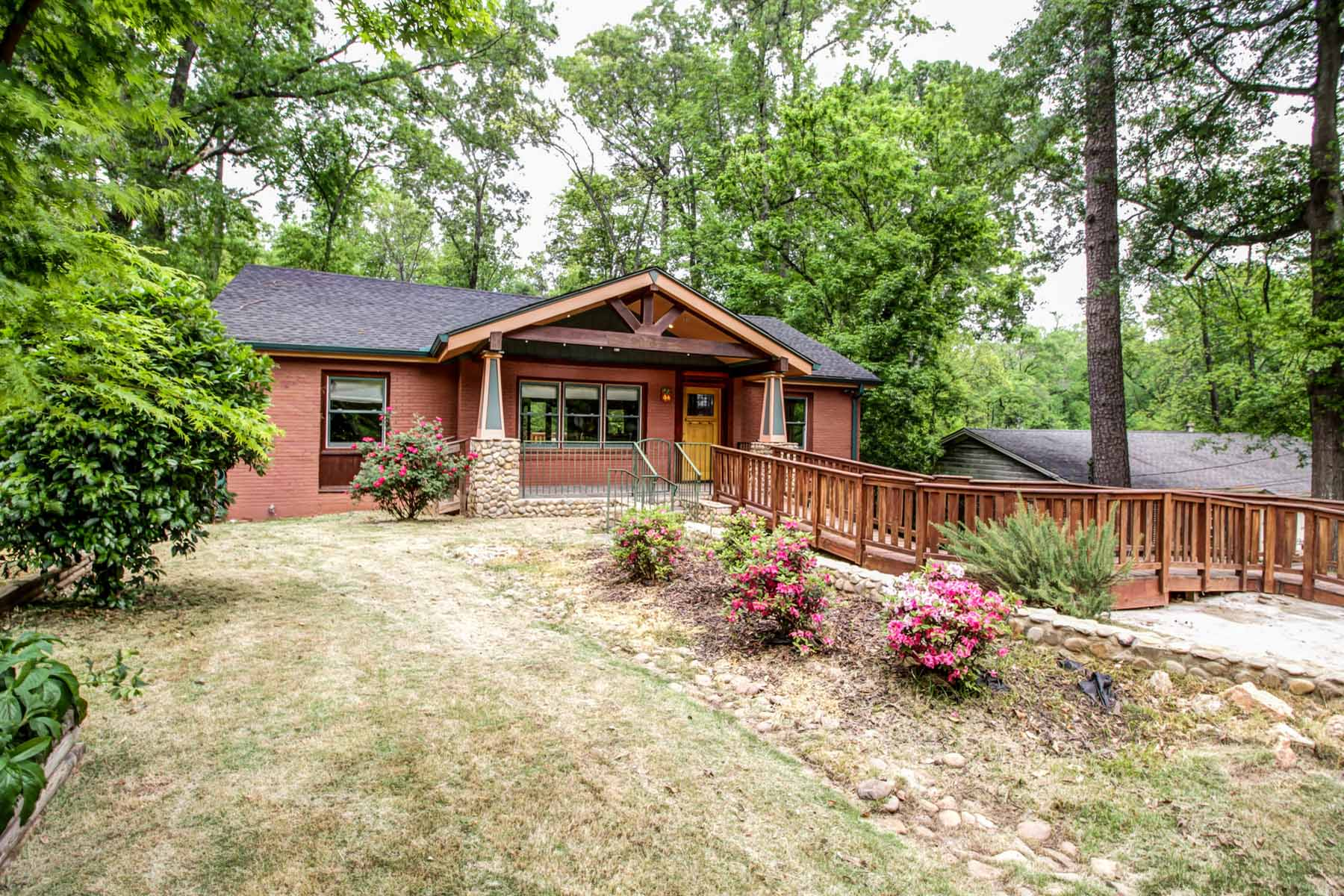 sales property at River rock cottage on estate lot with private, wooded views