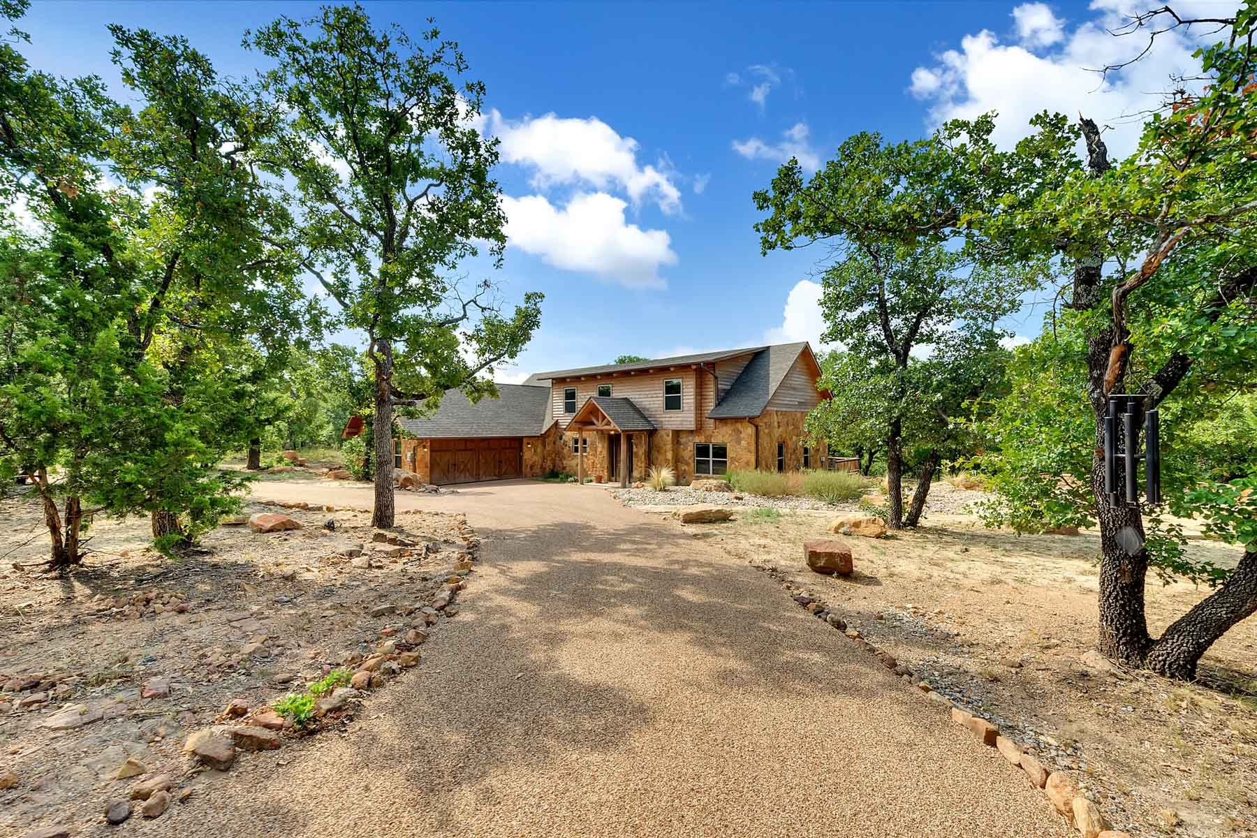 Nhà ở một gia đình vì Bán tại Beautiful and Rustic Custom built stone and log Home 1508 Arts Way Gordon, Texas 76453 Hoa Kỳ