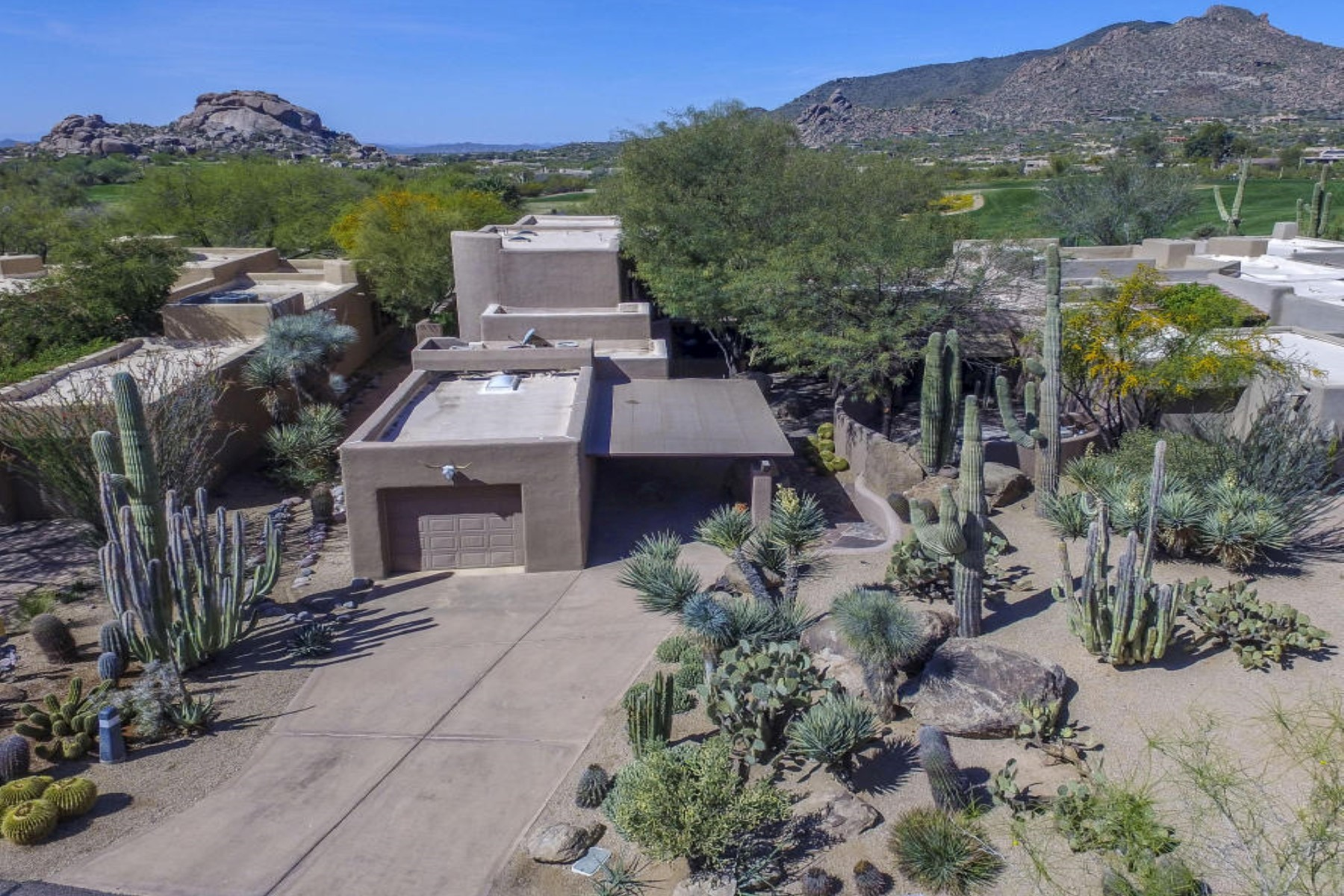 sales property at Southwest inspired Boulders home