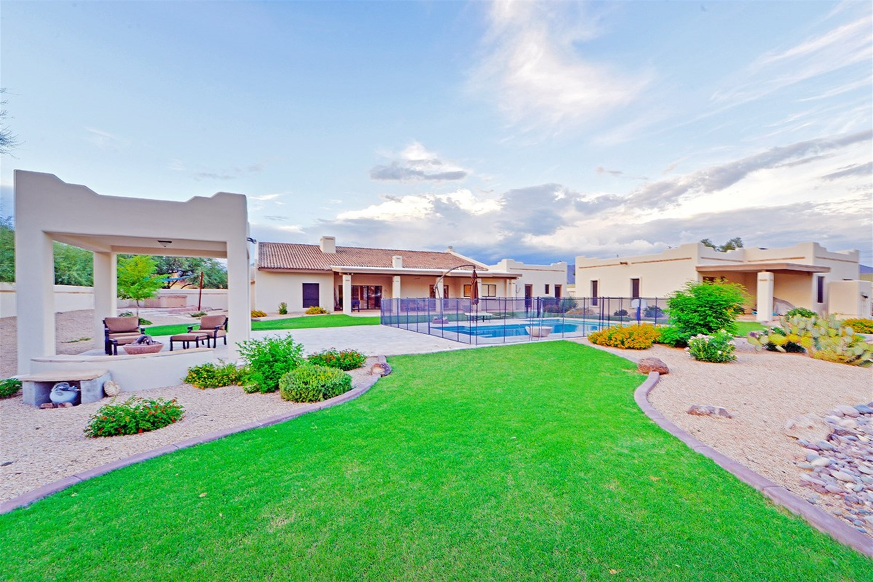Property For Sale at At the end of a long lazy cul-de-sac is a truly sublime lush desert lot