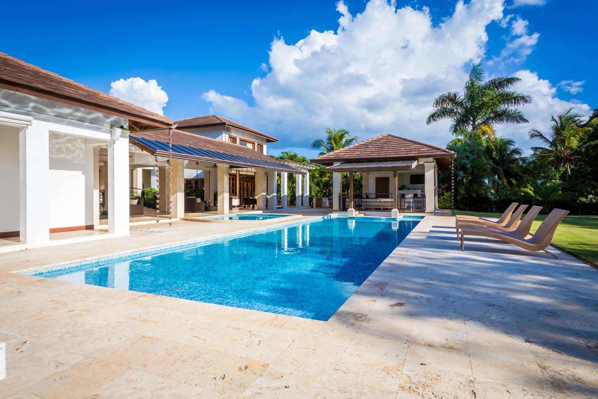 sales property at A Tropical-Modern Mansion with Vibrant Golf View designed for a family of 20
