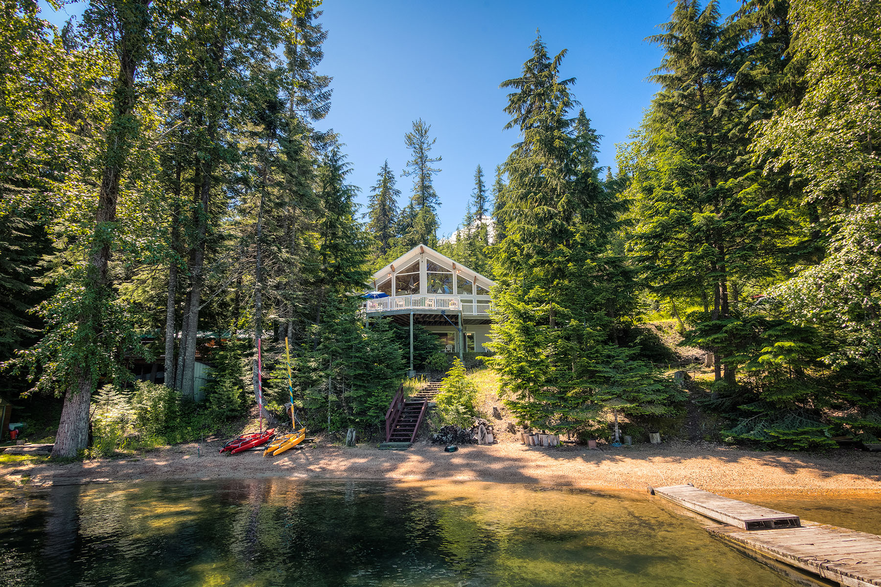Single Family Home for Sale at Sunsets on the Beach Waterfront Home 10147 N Speakeasy Ln Hayden, Idaho, 83835 United States