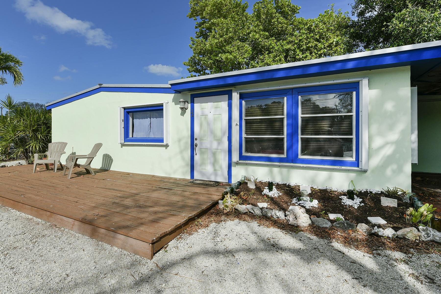 Nhà ở một gia đình vì Bán tại Cute Cottage 32 Pirates Drive Key Largo, Florida, 33070 Hoa Kỳ