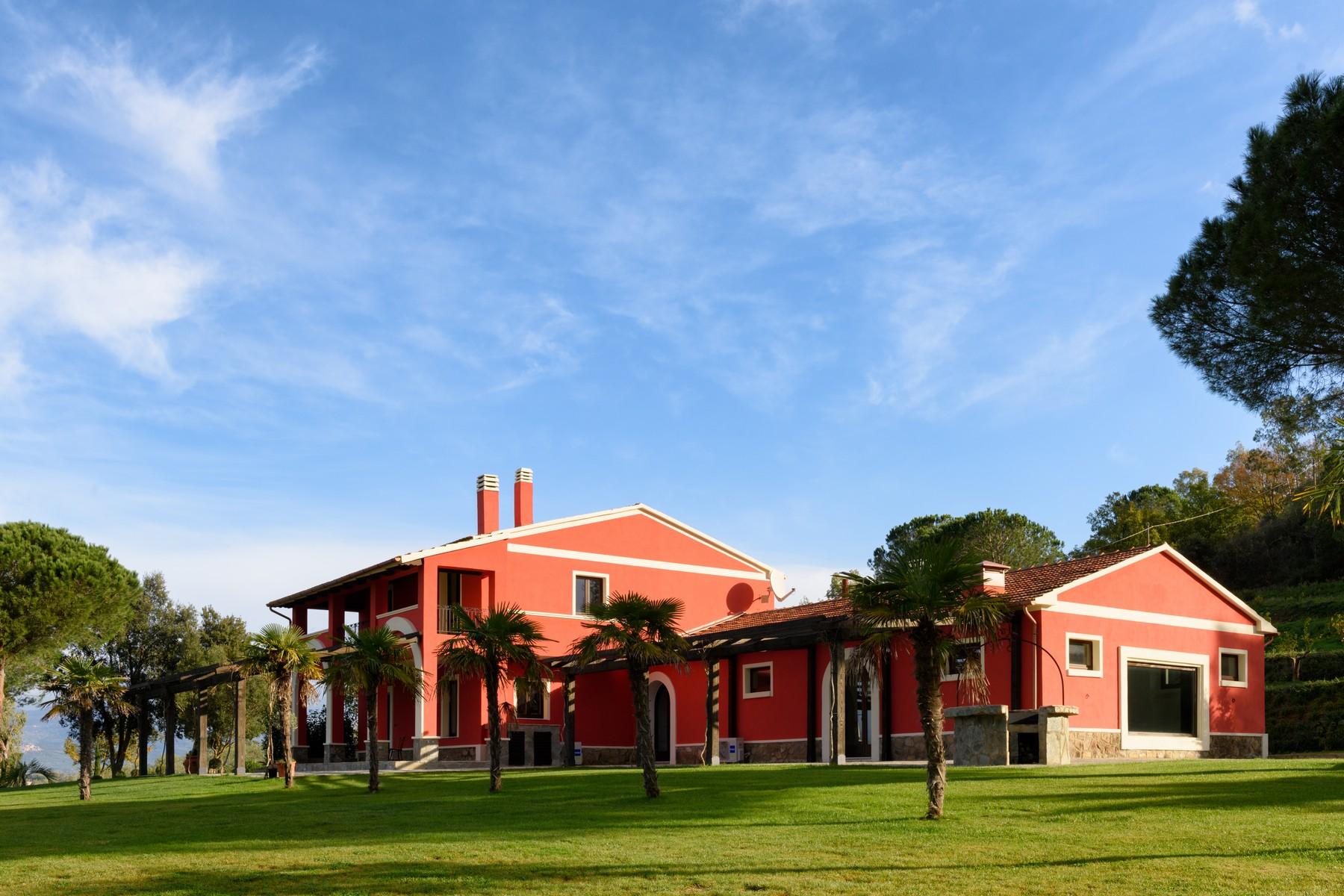 Farm / Ranch / Plantation for Sale at : Incomparable renovated villa surrounded by Olive trees Gavorrano Castiglione Della Pescaia, Grosseto 58023 Italy