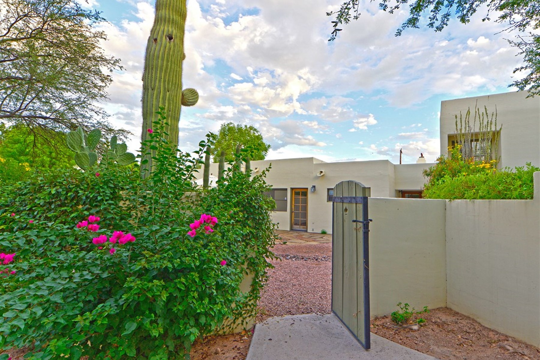 Property For Sale at Crisp and white in the historic guard-gated patio home community of Casa Blanca.