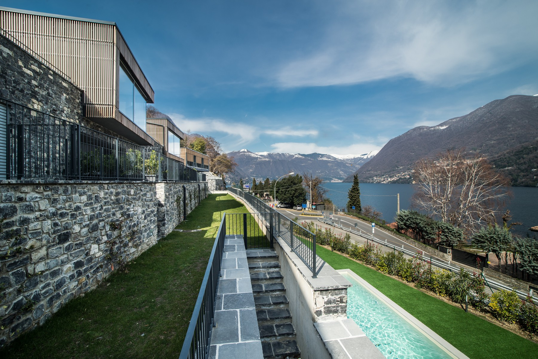 Additional photo for property listing at Prestigious modern villa with private swimming pool and magnificent Lake views Laglio Laglio, Como 22010 Italy