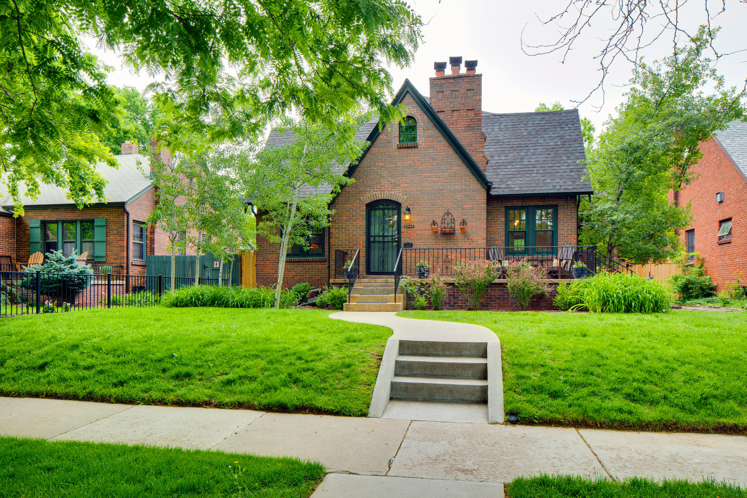 Single Family Home for Sale at Perfectly Situated Two-Story Tudor in Park Hill 2046 Kearney Street Denver, Colorado, 80207 United States