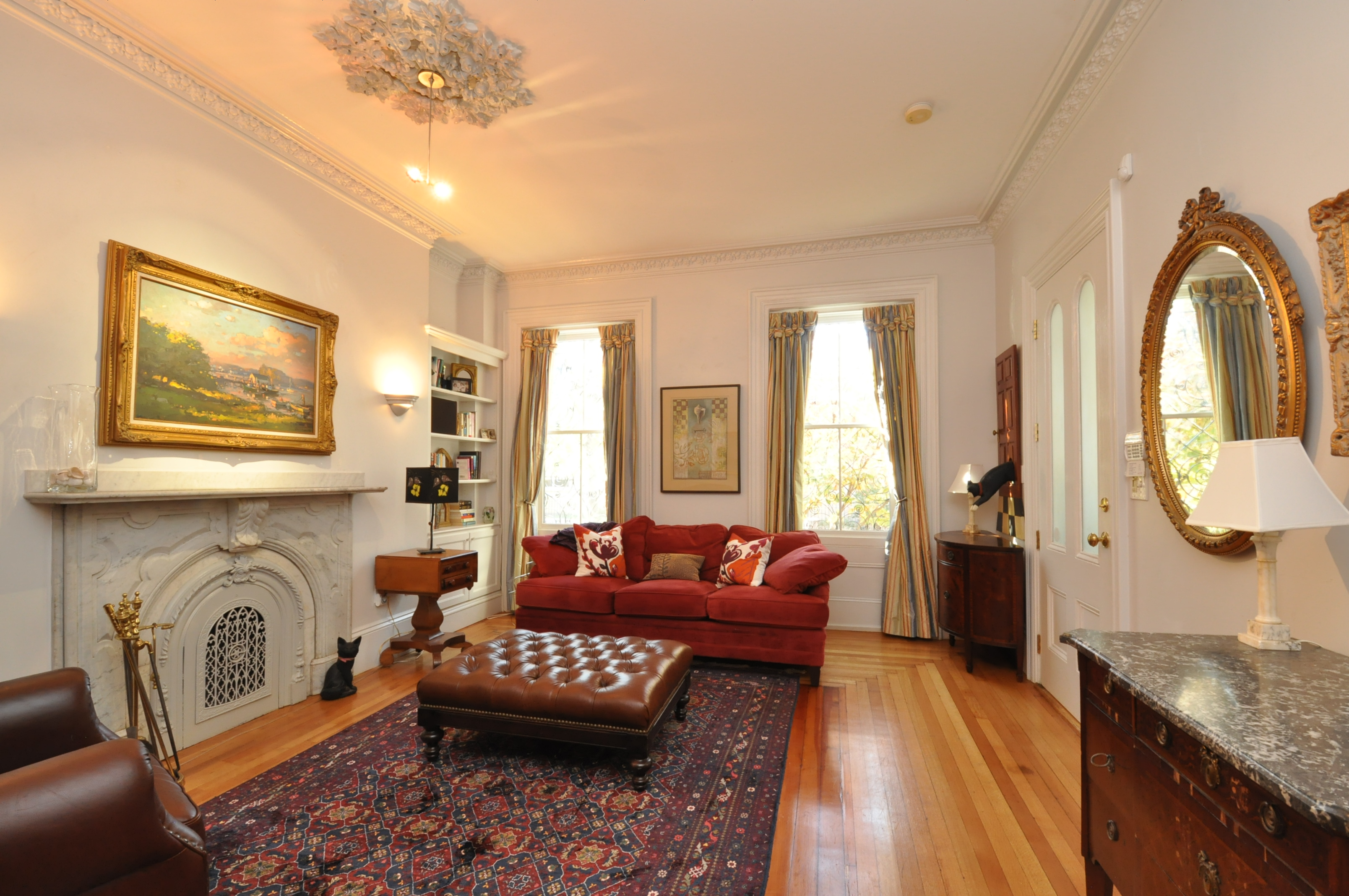 Property For Sale at This charming and spacious parlor and garden duplex is a South End jewel.