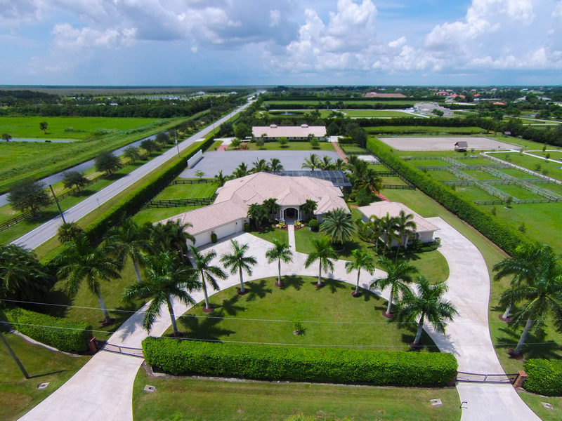 Moradia para Venda às 4985 Stables Way Palm Beach Point East, Wellington, Florida 33414 Estados Unidos